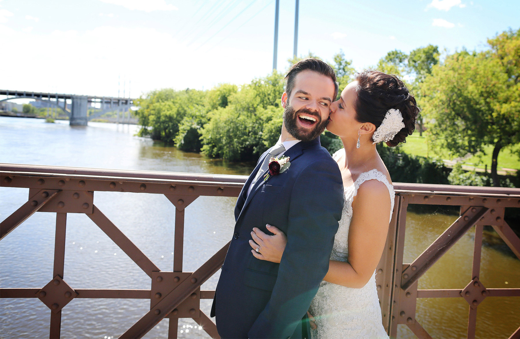 06-Minneapolis-Minnesota-Wedding-Photographer-by-Andrew-Vick-Photography-Summer-First-Meeting-Look-Bride-Groom-Merriam-Street-Bridge-Mississippi-River-Kiss-Ashley-and-Eric.jpg