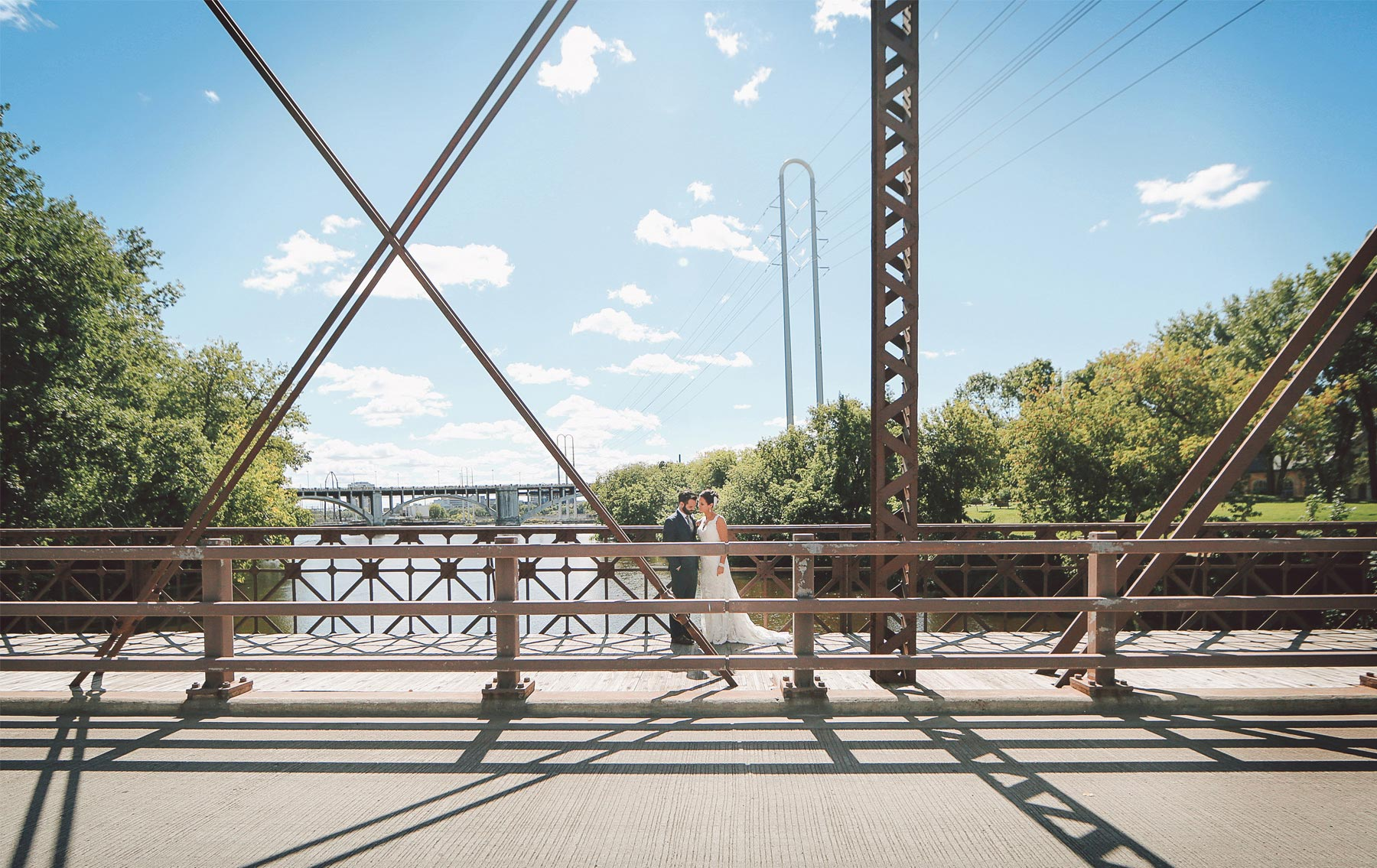 09-Minneapolis-Minnesota-Wedding-Photographer-by-Andrew-Vick-Photography-Summer-First-Meeting-Look-Bride-Groom-Merriam-Street-Bridge-Mississippi-River-Vintage-Ashley-and-Eric.jpg