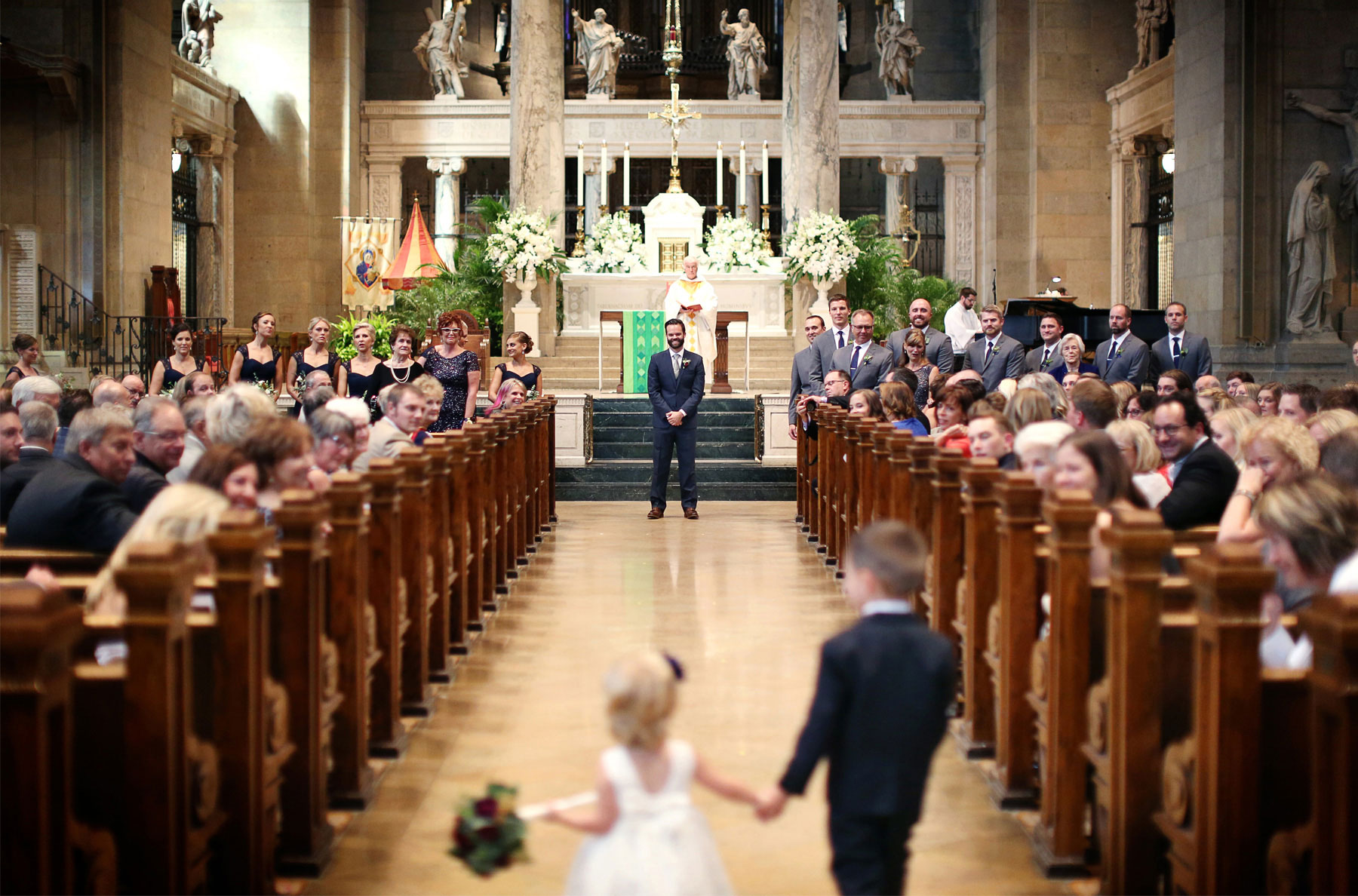 12-Minneapolis-Minnesota-Wedding-Photographer-by-Andrew-Vick-Photography-Summer-Basilica-of-Saint-Mary-Church-Ceremony-Groom-Flower-Girl-Ring-Bearer-Aisle-Ashley-and-Eric.jpg