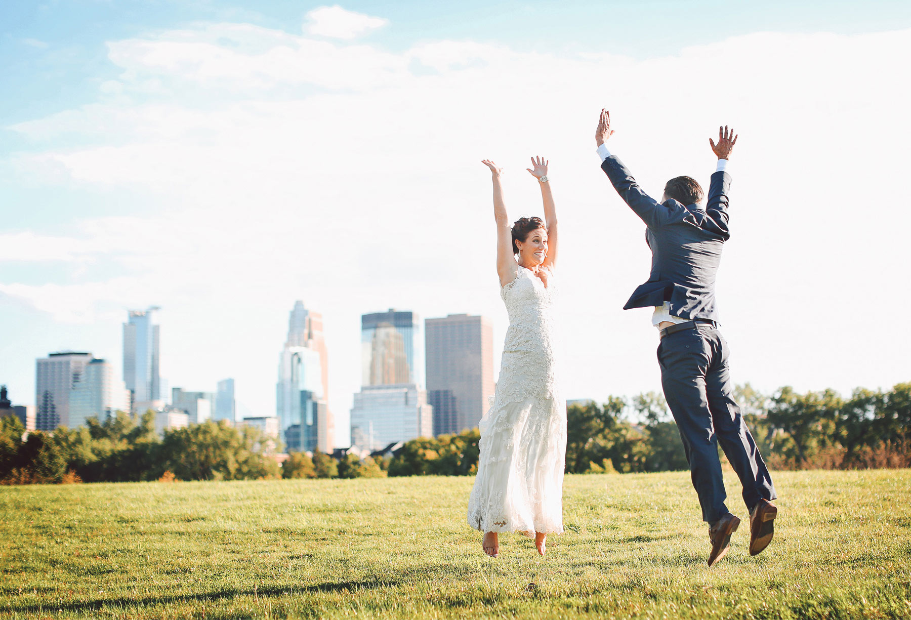 21-Minneapolis-Minnesota-Wedding-Photographer-by-Andrew-Vick-Photography-Summer-Boom-Island-Park-Bride-Groom-Jumping-Vintage-Ashley-and-Eric.jpg