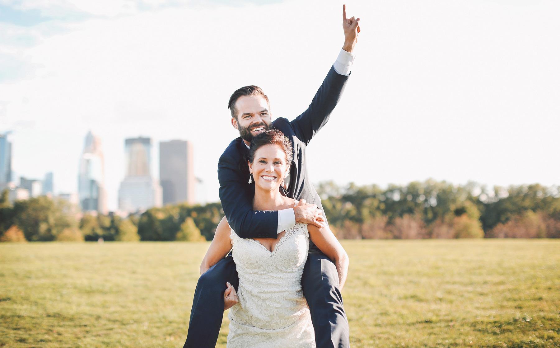 22-Minneapolis-Minnesota-Wedding-Photographer-by-Andrew-Vick-Photography-Summer-Boom-Island-Park-Bride-Groom-Piggyback-Ride-Vintage-Ashley-and-Eric.jpg