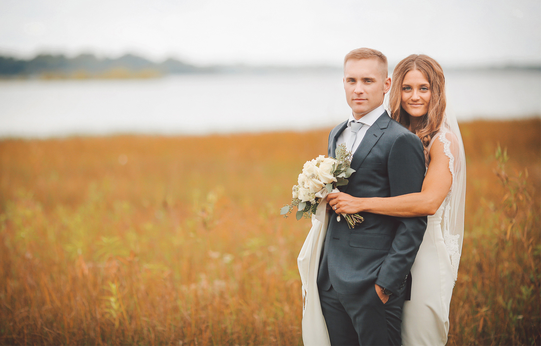 13-Dellwood-Minnesota-Wedding-Photographer-by-Andrew-Vick-Photography-Summer-Country-Club-First-Meeting-Look-Bride-Groom-Embrace-White-Bear-Lake-Vintage-Sarah-and-Landon.jpg