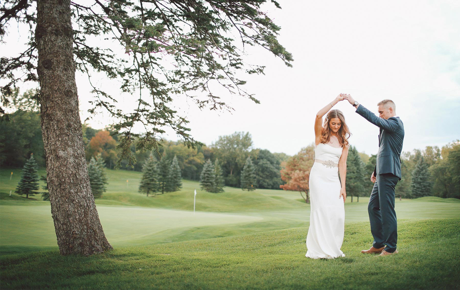 24-Dellwood-Minnesota-Wedding-Photographer-by-Andrew-Vick-Photography-Summer-Country-Club-Reception-Bride-Groom-Golf-Course-Twirl-Vintage-Sarah-and-Landon.jpg