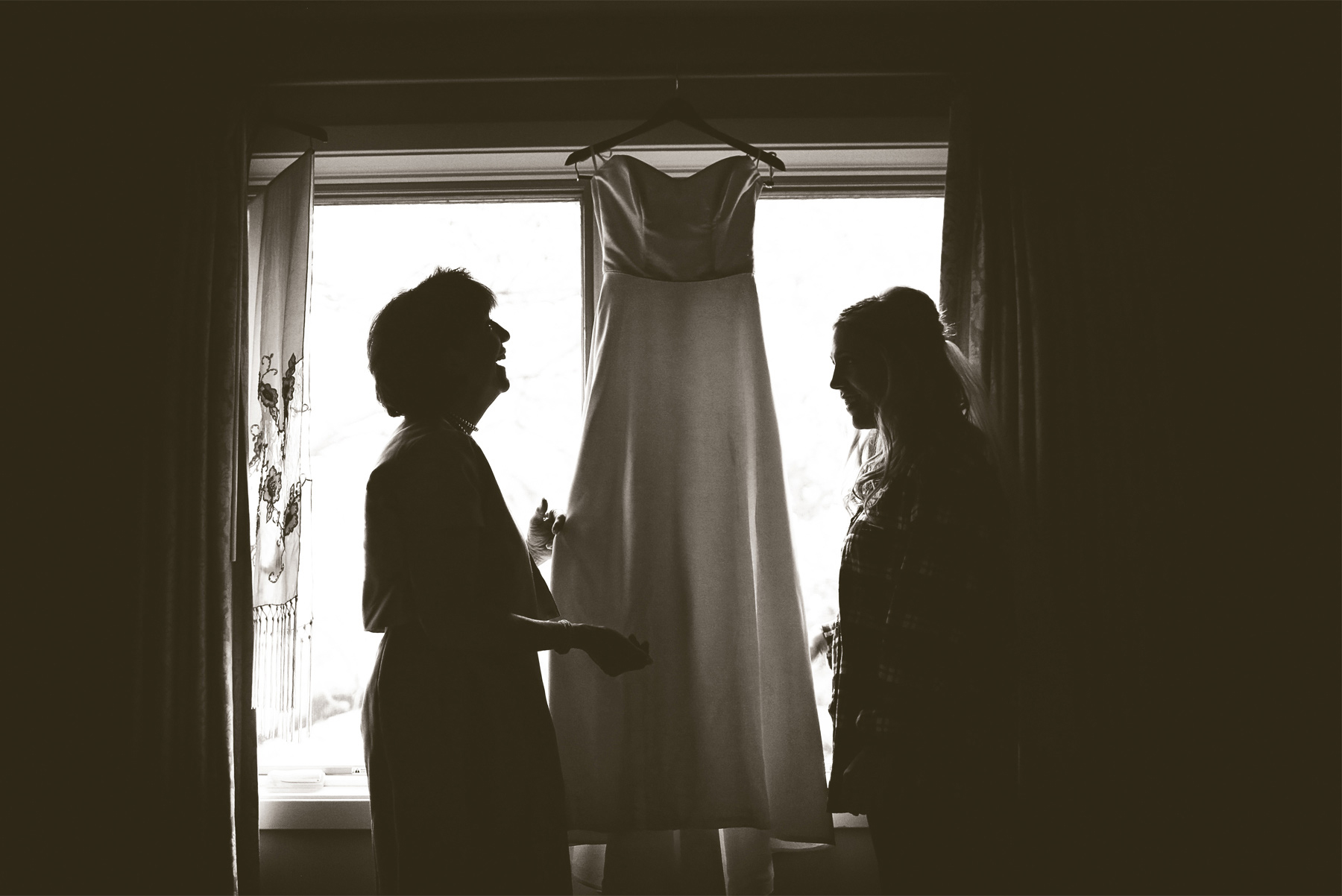 01-Minneapolis-Minnesota-Wedding-Photographer-by-Andrew-Vick-Photography-Fall-Autumn-Parents-House-Getting-Ready-Bride-Mother-Dress-Sepia-Krissy-and-James.jpg