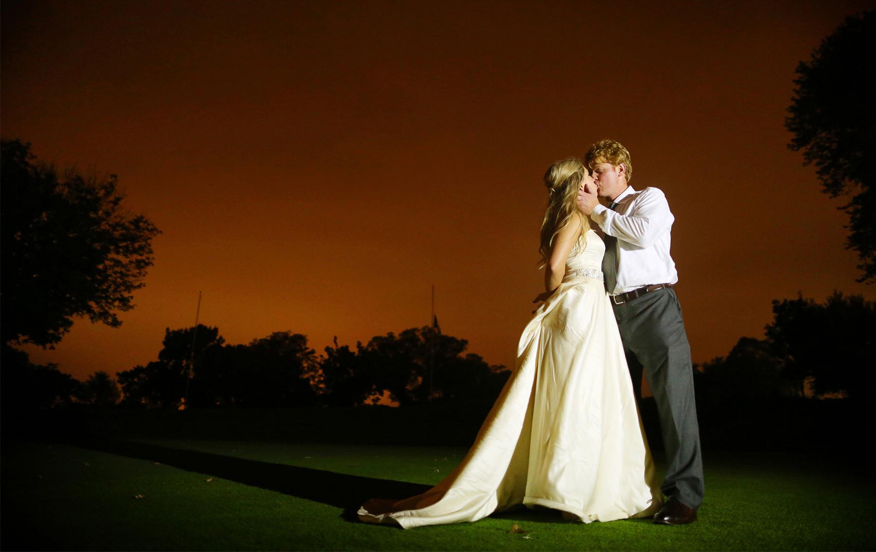 24-Minneapolis-Minnesota-Wedding-Photographer-by-Andrew-Vick-Photography-Fall-Autumn-Minikahda-Club-Golf-Course-Night-Kiss-Krissy-and-James.jpg