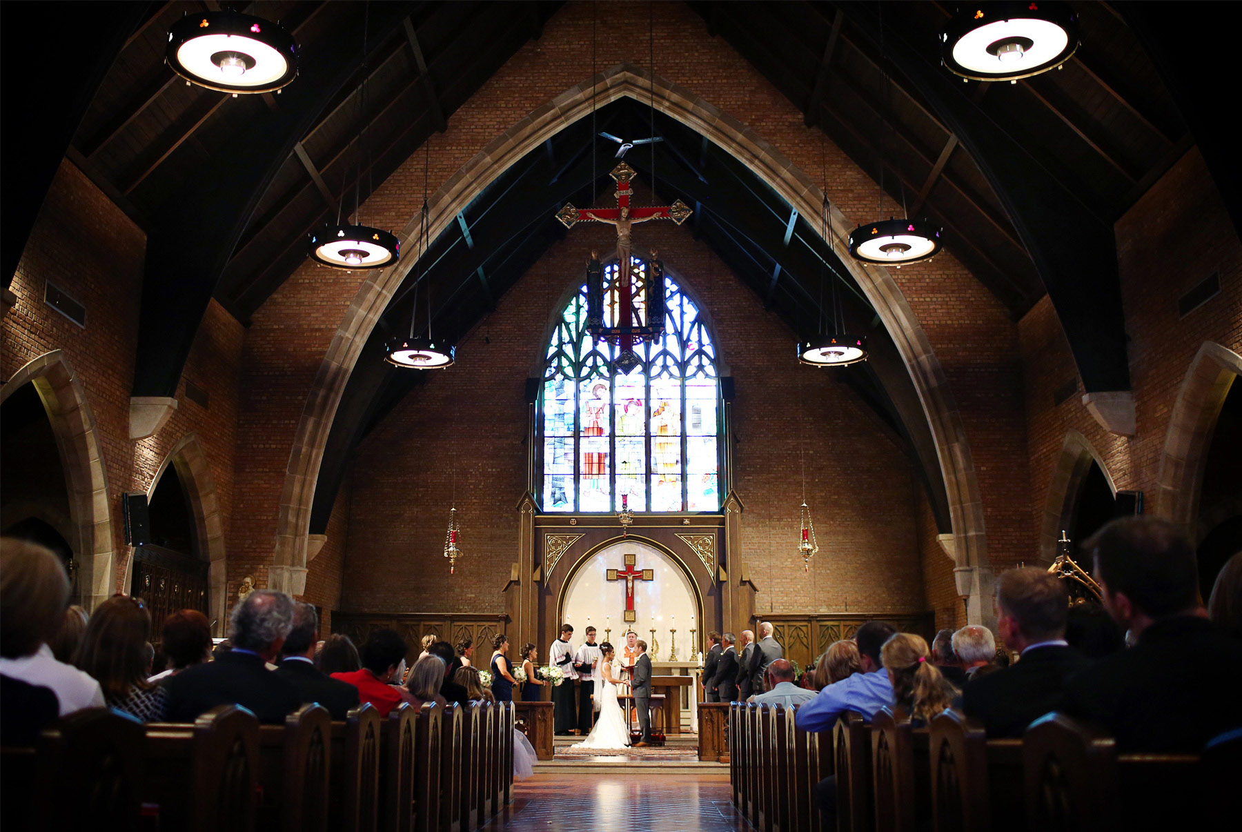 07-Saint-Louis-Park-Minnesota-Wedding-Photographer-by-Andrew-Vick-Photography-Fall-Autumn-Holy-Family-Catholic-Church-Ceremony-Bride-Groom-Vows-Paula-and-Jason.jpg