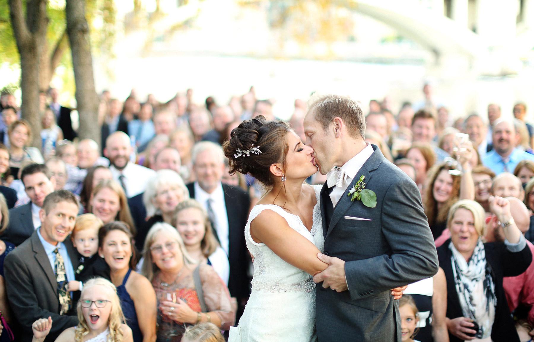 22-Minneapolis-Minnesota-Wedding-Photographer-by-Andrew-Vick-Photography-Fall-Autumn-Bride-Groom-Guests-Kiss-Paula-and-Jason.jpg