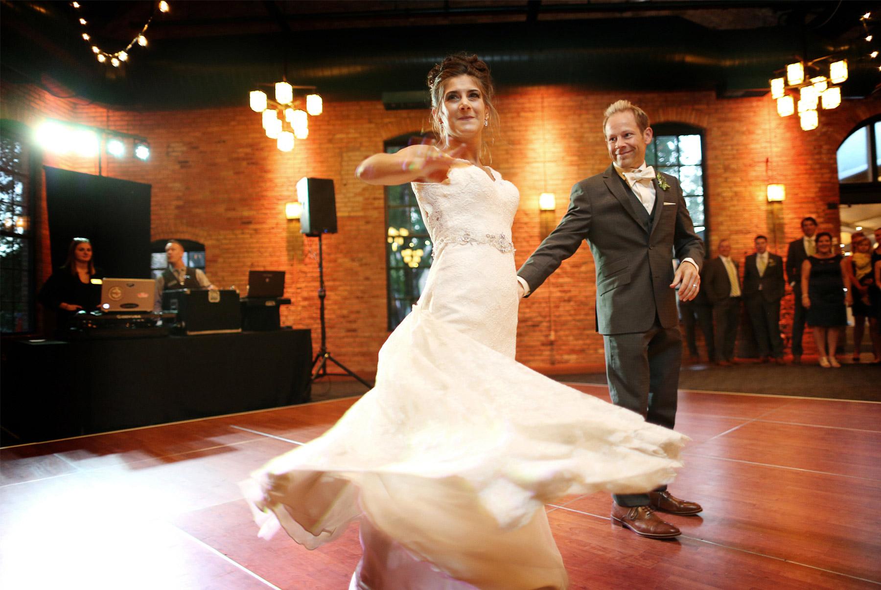 25-Minneapolis-Minnesota-Wedding-Photographer-by-Andrew-Vick-Photography-Fall-Autumn-Nicollet-Island-Pavillion-Bride-Groom-Dance-Spin-Twirl-Paula-and-Jason.jpg