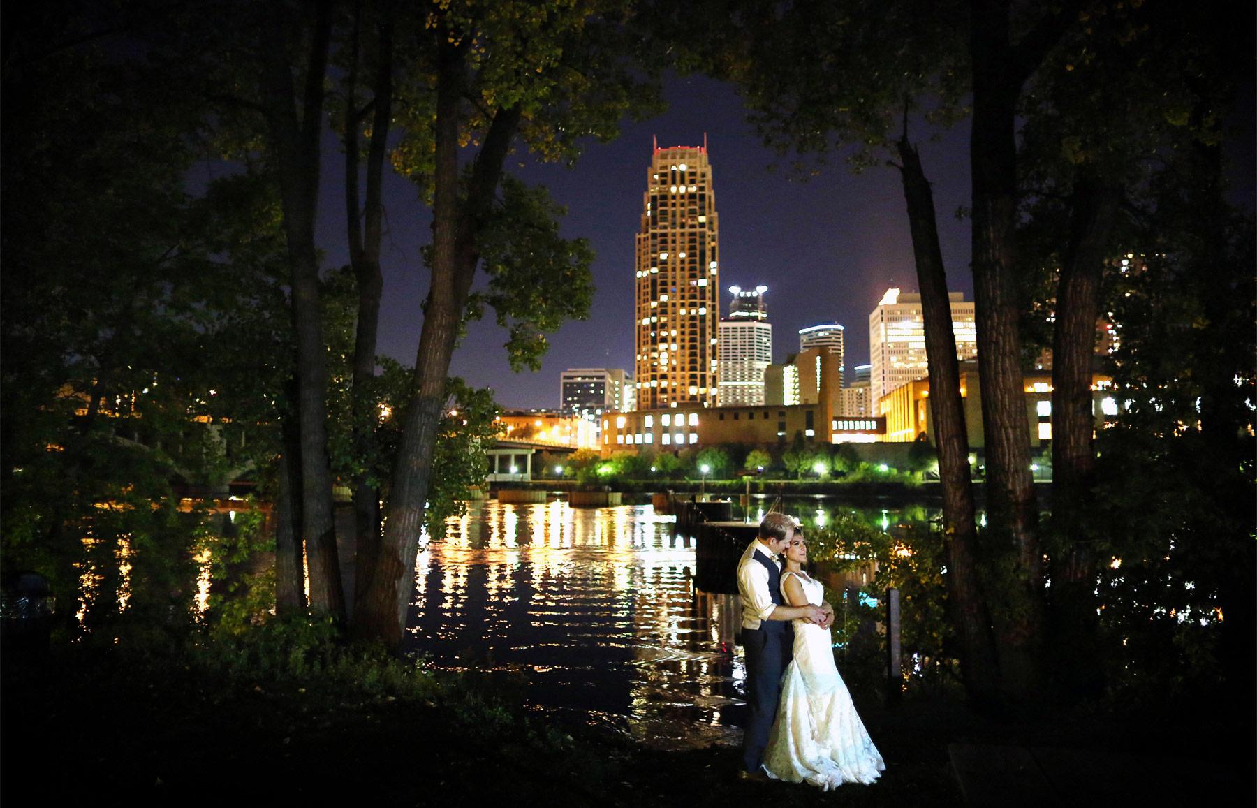 26-Minneapolis-Minnesota-Wedding-Photographer-by-Andrew-Vick-Photography-Fall-Autumn-Mississippi-River-Bride-Groom-Embrace-Paula-and-Jason.jpg