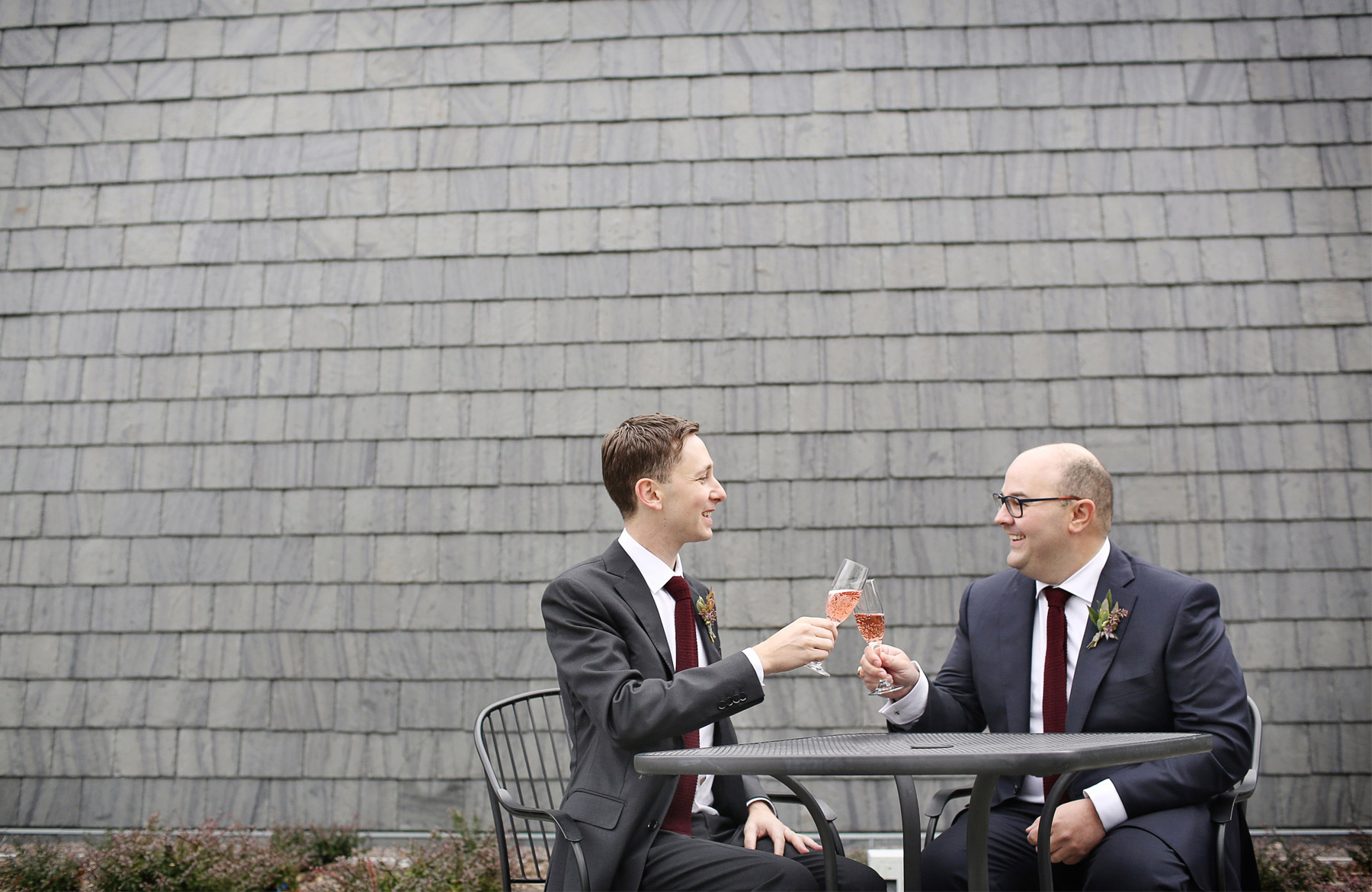 05-Minneapolis-Minnesota-Wedding-Photographer-by-Andrew-Vick-Photography-Fall-Autumn-American-Swedish-Institute-First-Meeting-Look-Groom-Pink-Champagne-Ben-and-Adam.jpg