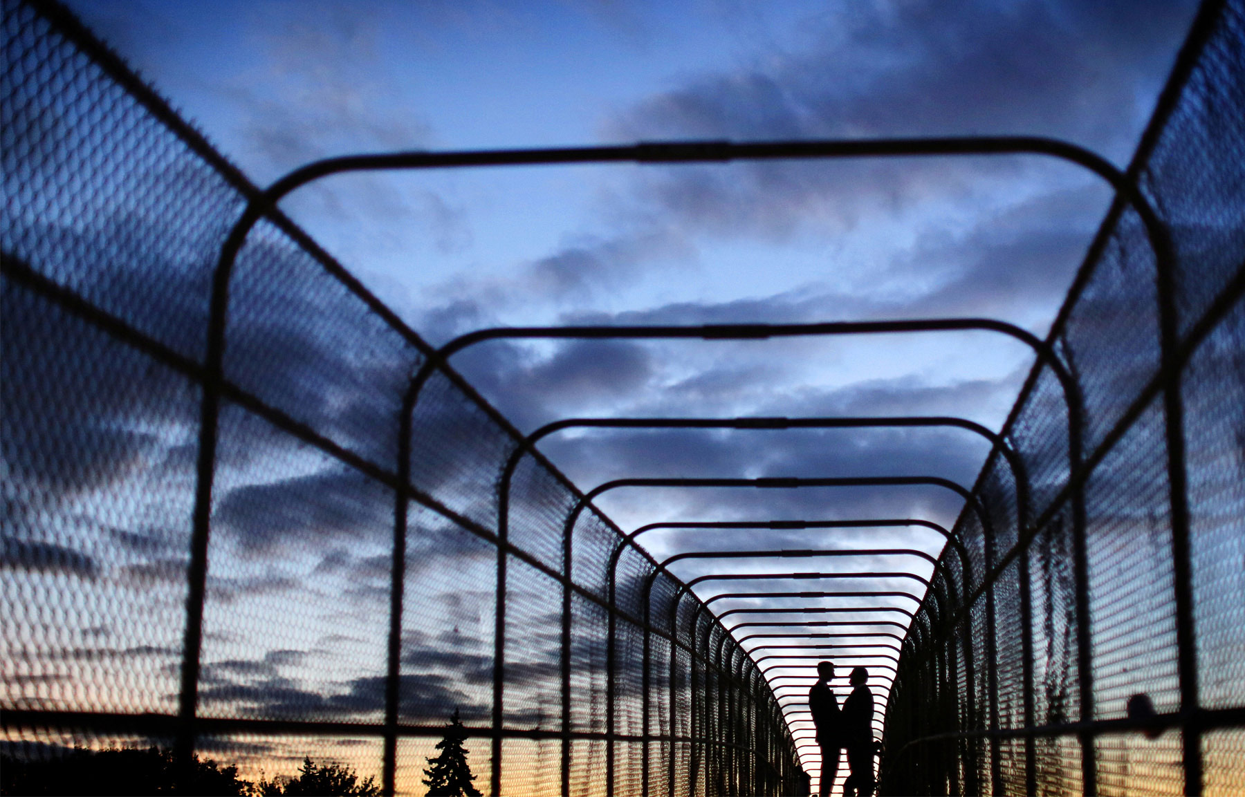 18-Minneapolis-Minnesota-Wedding-Photographer-by-Andrew-Vick-Photography-Fall-Autumn-Pedestrian-Bridge-Groom-Silhouette-Night-Sky-Sunset-Ben-and-Adam.jpg