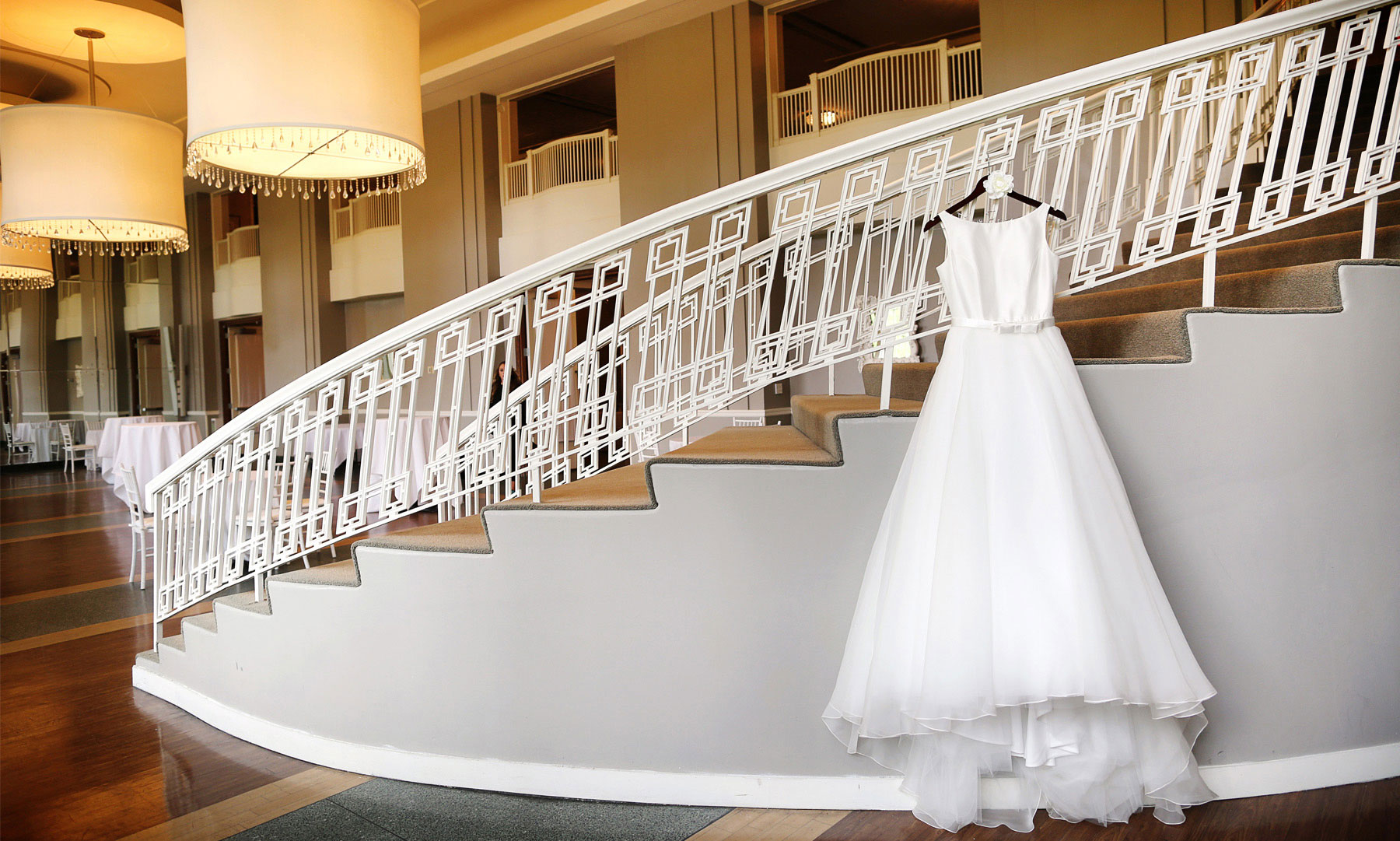 01-Minneapolis-Minnesota-Wedding-Photographer-by-Andrew-Vick-Photography-Fall-Autumn-Calhoun-Beach-Club-Getting-Ready-Dress-Staircase-Stairs-Kristy-and-Jack.jpg