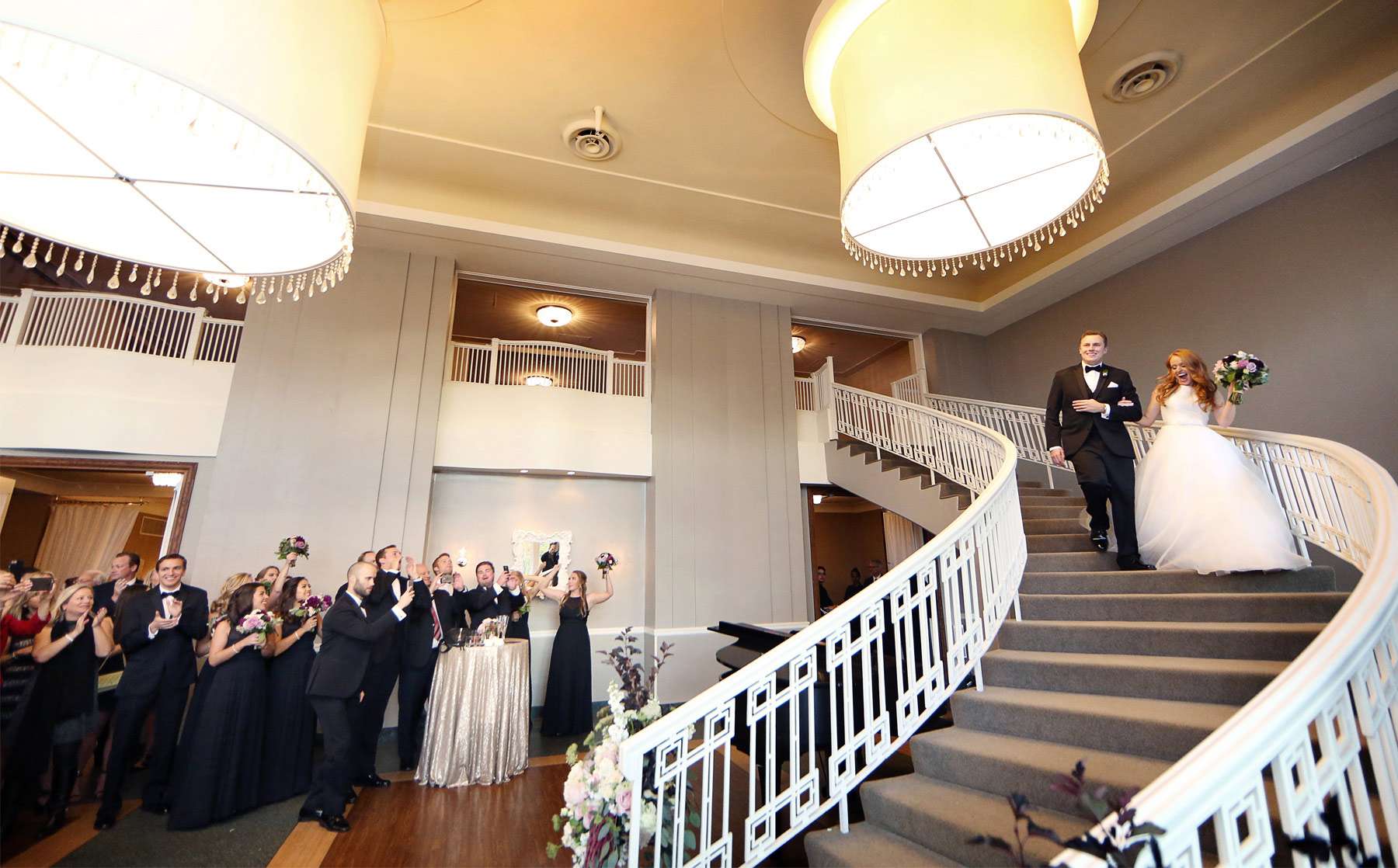 26-Minneapolis-Minnesota-Wedding-Photographer-by-Andrew-Vick-Photography-Fall-Autumn-Calhoun-Beach-Club-Reception-Bride-Groom-Grand-March-Guests-Staircase-Stairs-Kristy-and-Jack.jpg