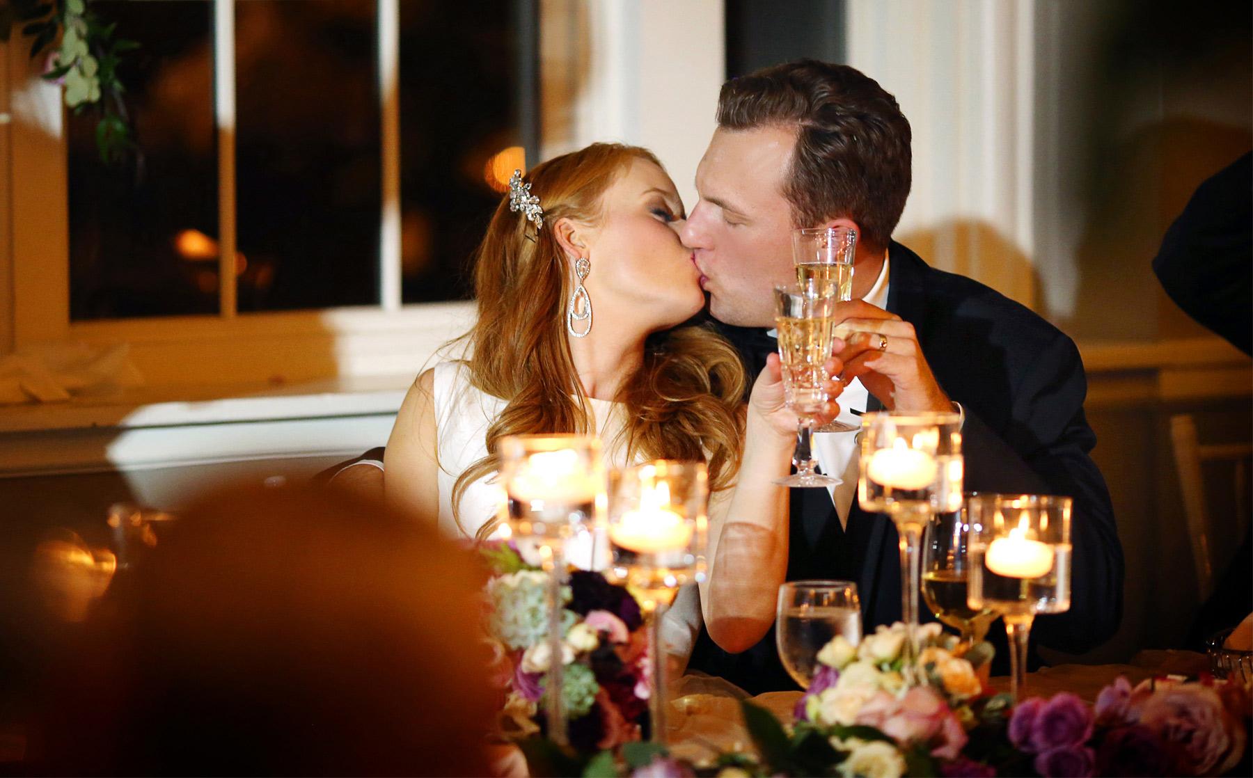 30-Minneapolis-Minnesota-Wedding-Photographer-by-Andrew-Vick-Photography-Fall-Autumn-Calhoun-Beach-Club-Reception-Bride-Groom-Kiss-Champagne-Kristy-and-Jack.jpg