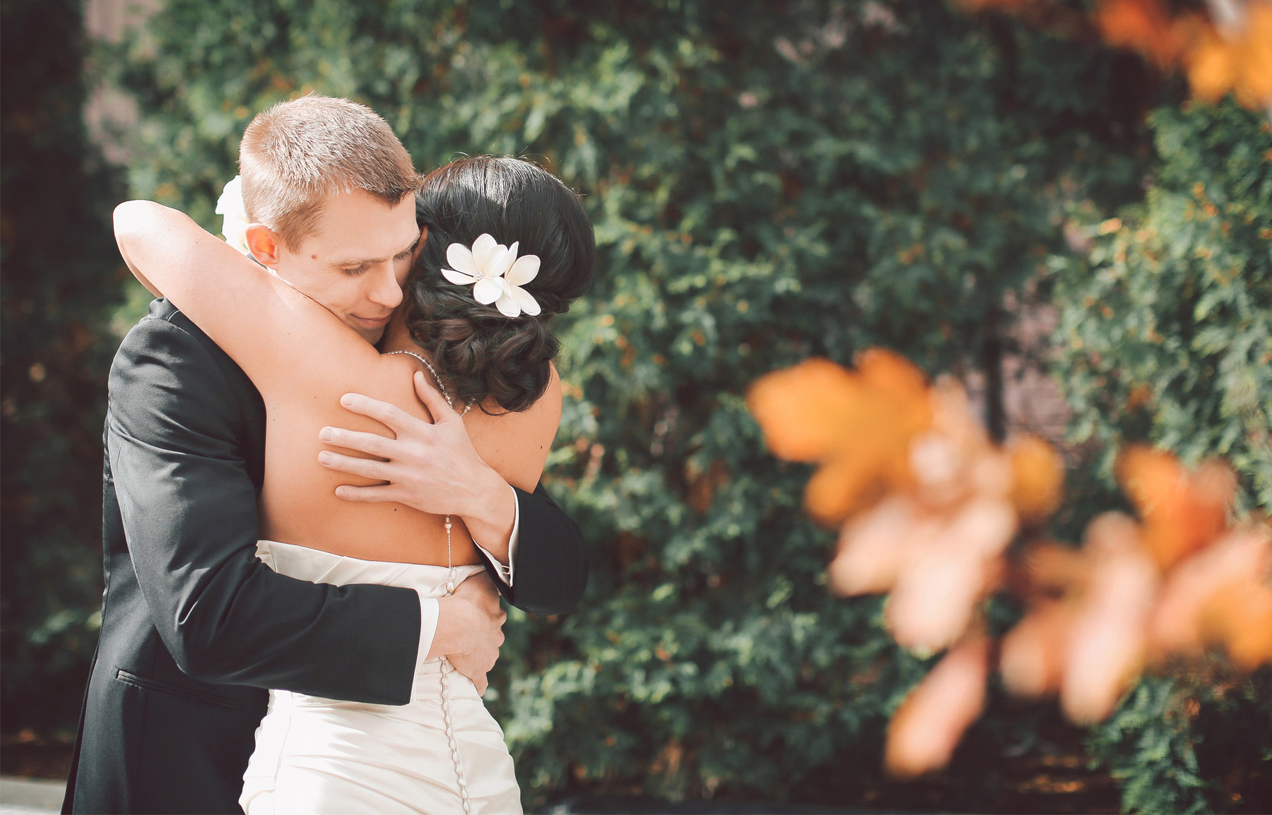 07-Minneapolis-Minnesota-Wedding-Photographer-by-Andrew-Vick-Photography-Fall-Autumn-Millennium-Hotel-First-Look-Meeting-Bride-Groom-Hug-Embrace-Vintage-Amanda-and-Cary.jpg