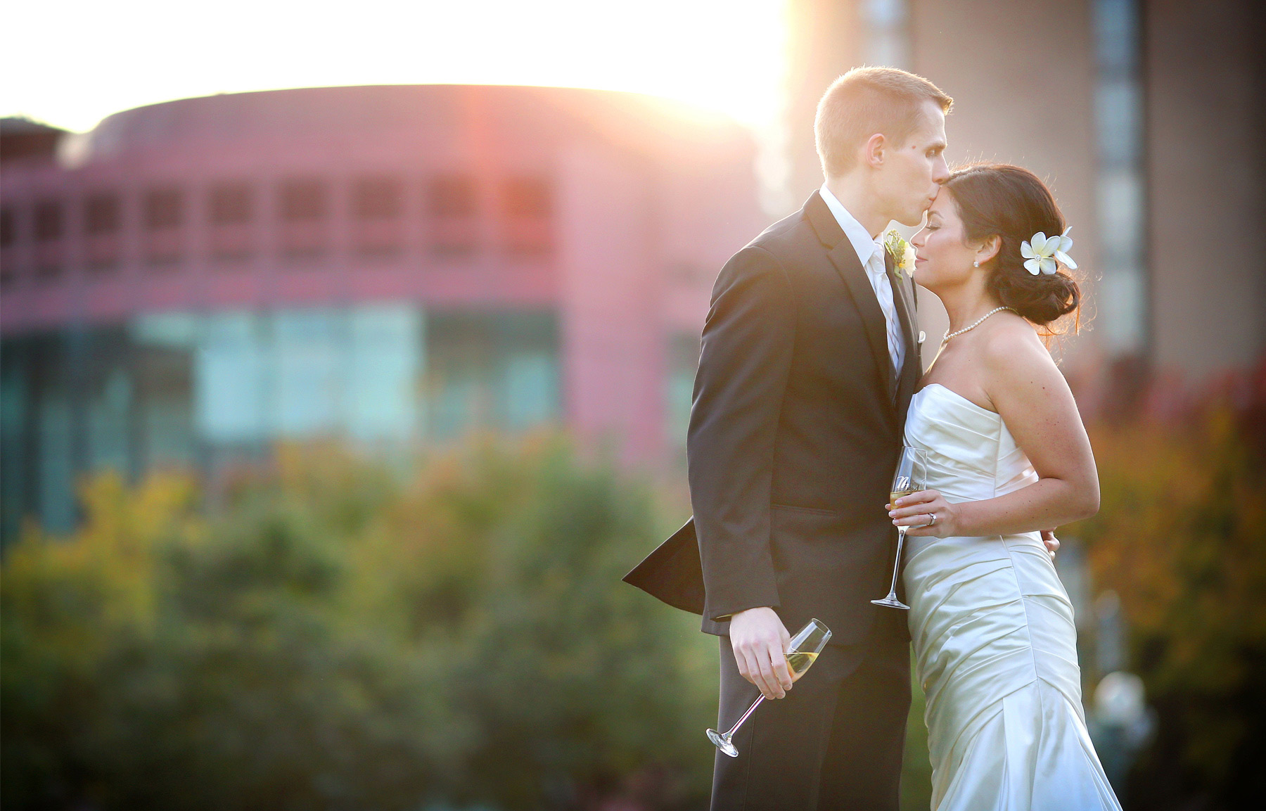 19-Minneapolis-Minnesota-Wedding-Photographer-by-Andrew-Vick-Photography-Fall-Autumn-Convention-Center-Bride-Groom-Champagne-Kiss-Amanda-and-Cary.jpg