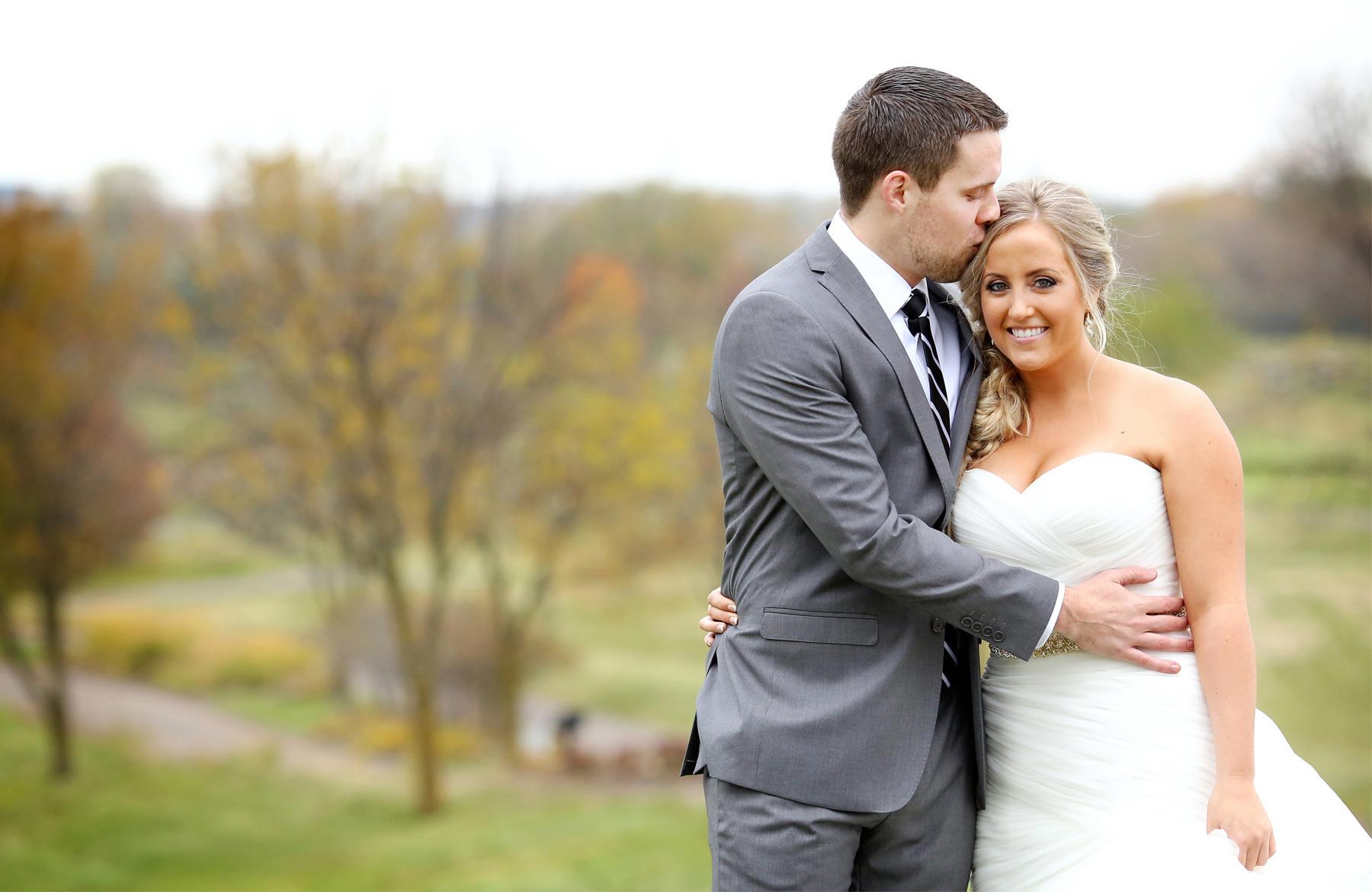 07-Stillwater-Minnesota-Wedding-Photographer-by-Andrew-Vick-Photography-Fall-Autumn-StoneRidge-Golf-Club-First-Meeting-Look-Bride-Groom-Hug-Embrace-Kiss-Hills-Field-Micaela-and-Derek.jpg