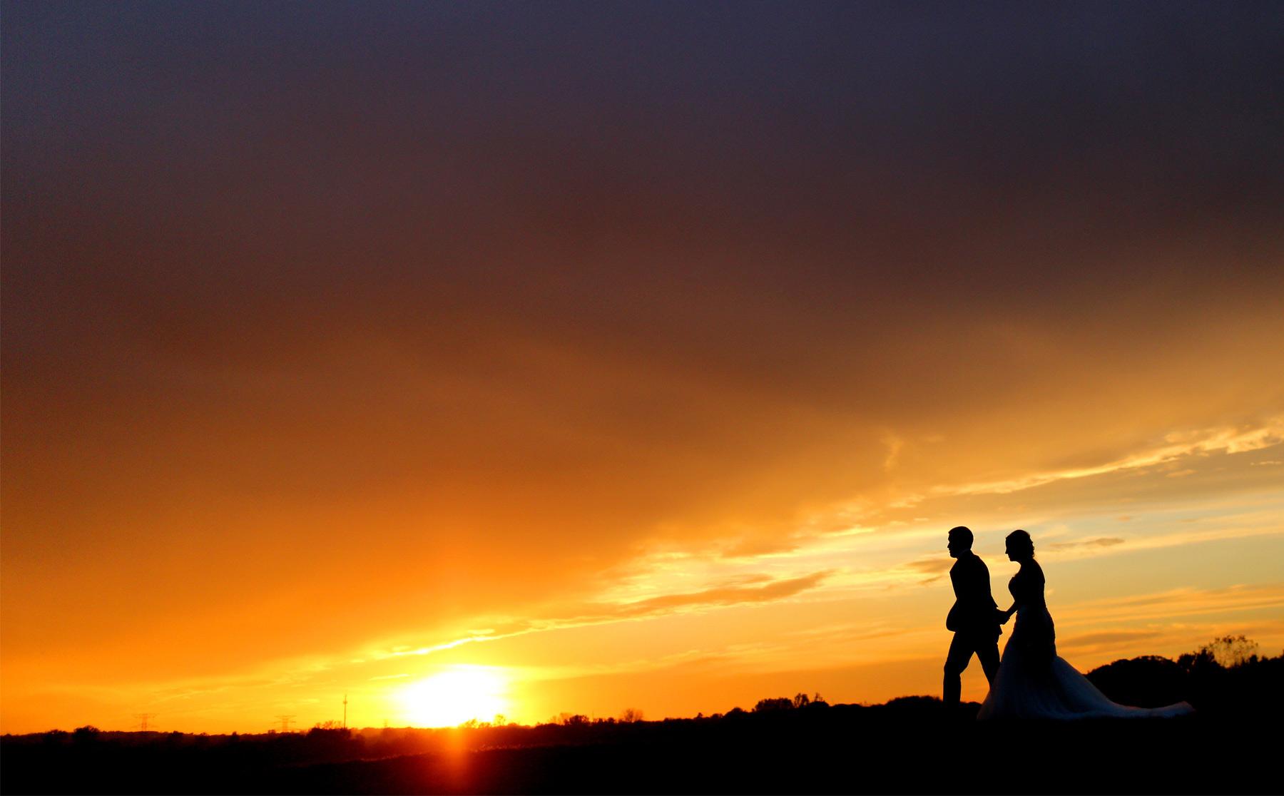 23-Stillwater-Minnesota-Wedding-Photographer-by-Andrew-Vick-Photography-Fall-Autumn-StoneRidge-Golf-Club-Bride-Groom-Silhouette-Sunset-Sunflare-Micaela-and-Derek.jpg