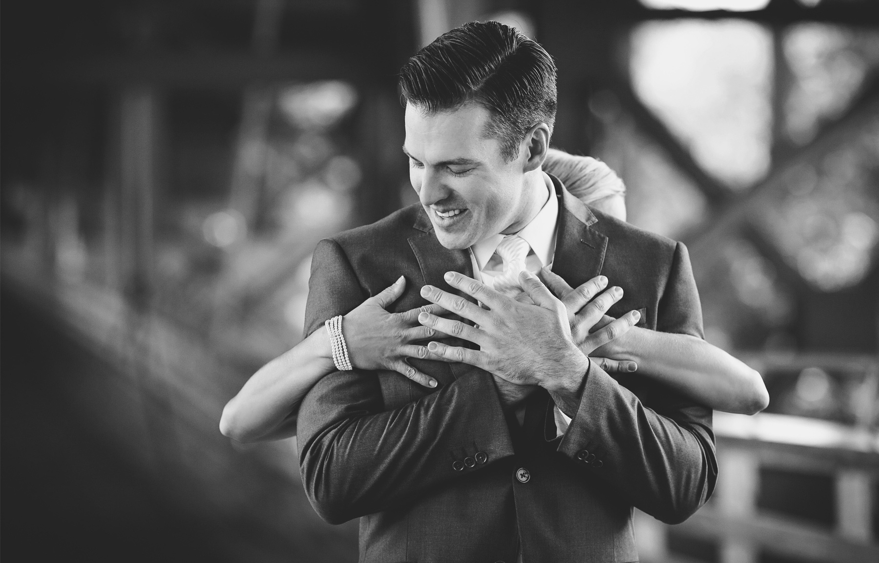 09-Milwaukee-Wisconsin-Wedding-Photographer-by-Andrew-Vick-Photography-Fall-Autumn-Destination-Holton-Bridge-Swing-Park-First-Meeting-Look-Bride-Groom-Embrace-Hug-Black-and-White-Tina-and-Kevin.jpg