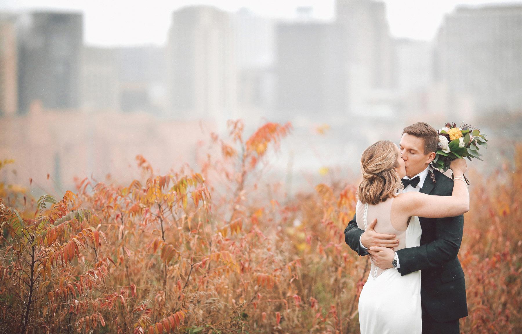 15-Saint-Paul-Minnesota-Wedding-Photographer-by-Andrew-Vick-Photography-Fall-Autumn-Bride-Groom-Flowers-Kiss-Rain-Vintage-Kathryn-and-Sam.jpg