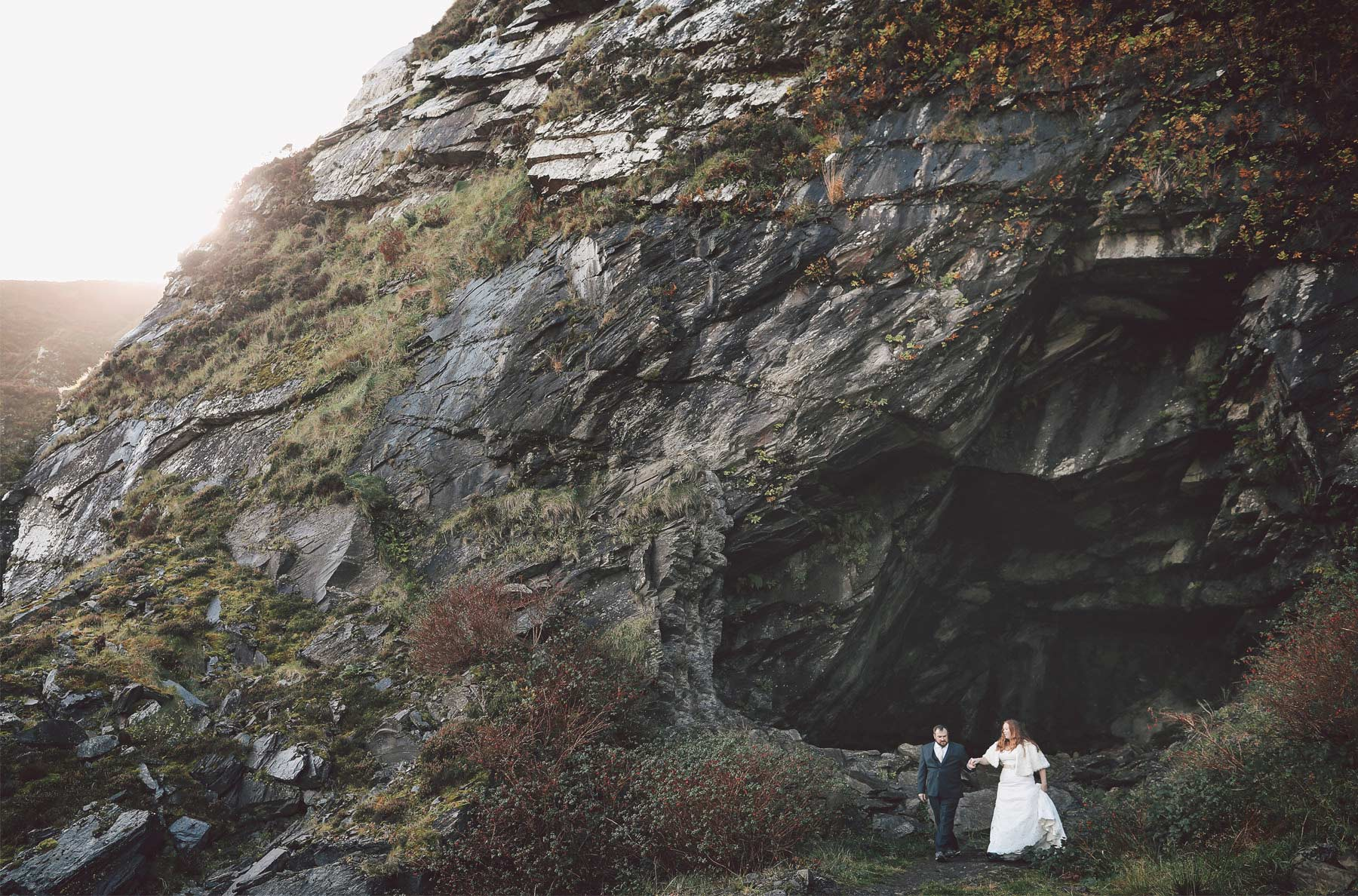 05-Kilarney-Ireland-Wedding-Photographer-by-Andrew-Vick-Photography-Fall-Autumn-Destination-Bride-Groom-Rocks-Cave-Holding-Hands-Vintage-Becca-and-Donal.jpg