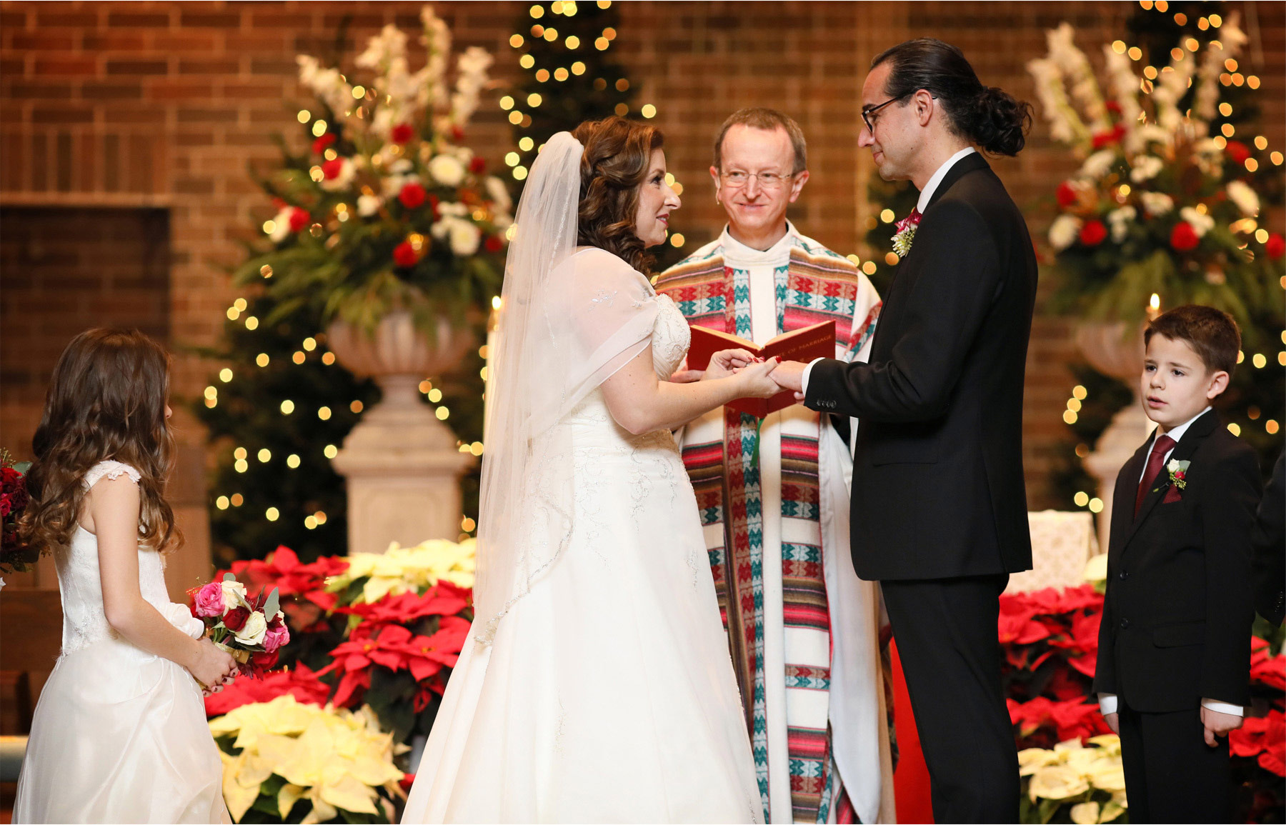 13-Edina-Minnesota-Wedding-Photographer-by-Andrew-Vick-Photography-Winter-Saint-Patricks-Catholic-Church-Ceremony-Bride-Groom-Rings-Elizabeth-and-Brian.jpg.jpg