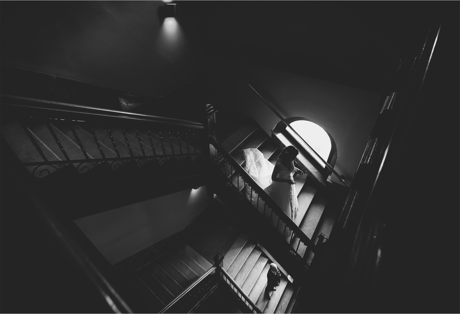 06-Saint-Paul-Minnesota-Wedding-Photographer-by-Andrew-Vick-Photography-Winter-New-Years-Eve-Embassy-Suites-First-Meeting-Look-Bride-Groom-Notes-Letter-Staircase-Stairs-Black-and-White-Emily-and-Michael.jpg