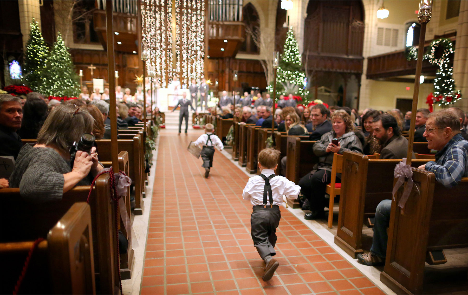 11-Minneapolis-Minnesota-Wedding-Photographer-by-Andrew-Vick-Photography-Winter-Central-Lutheran-Church-Ceremony-Groom-Ring-Bearer-Processional-Brittany-and-Joseph.jpg