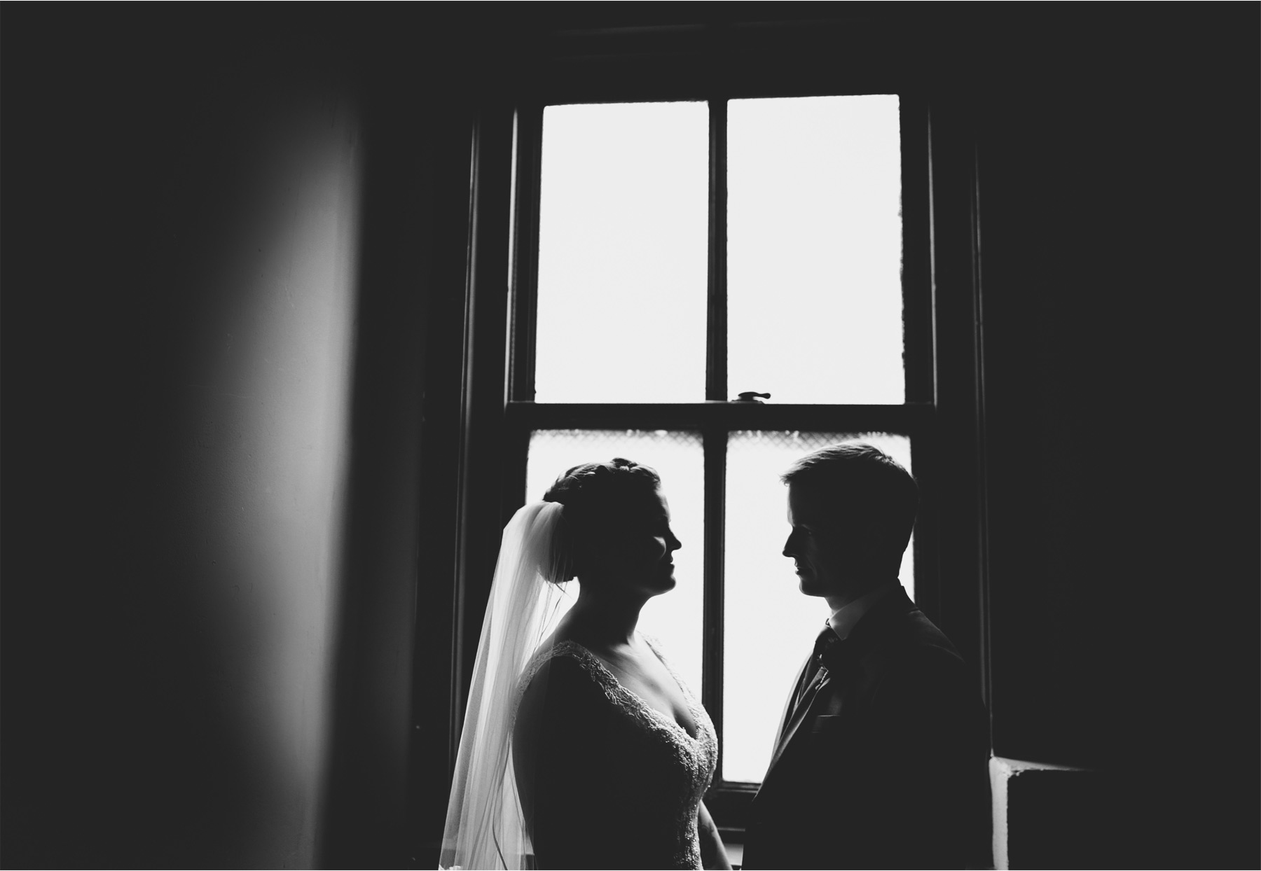 10-Chicago-Illinois-Wedding-Photographer-by-Andrew-Vick-Photography-Winter-Stan-Mansion-First-Meeting-Look-Bride-Groom-Black-and-White-Colleen-and-Mike.jpg