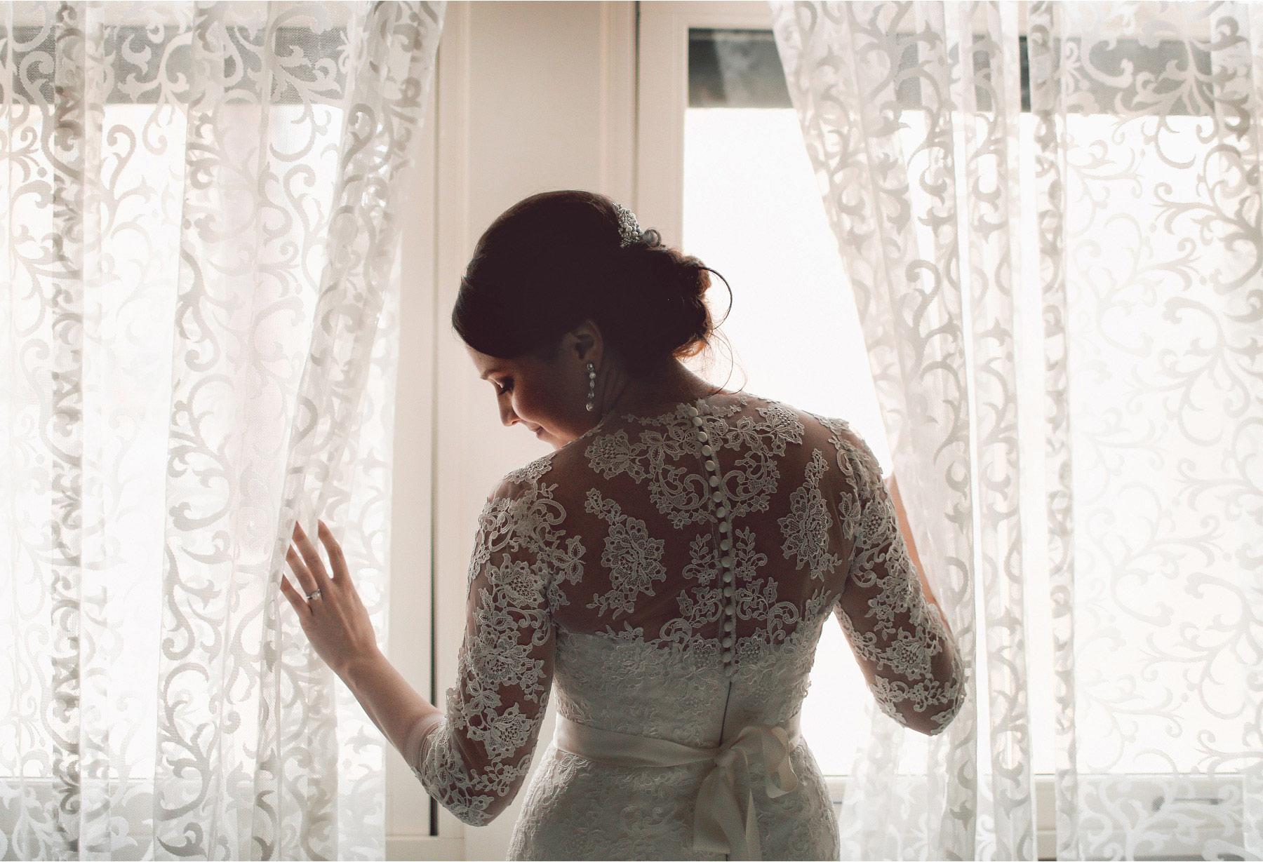 02-Minneapolis-Minnesota-Wedding-Photographer-by-Andrew-Vick-Photography-Winter-Renaissance-Hotel-Getting-Ready-Bride-Dress-Vintage-Sara-and-Rob.jpg