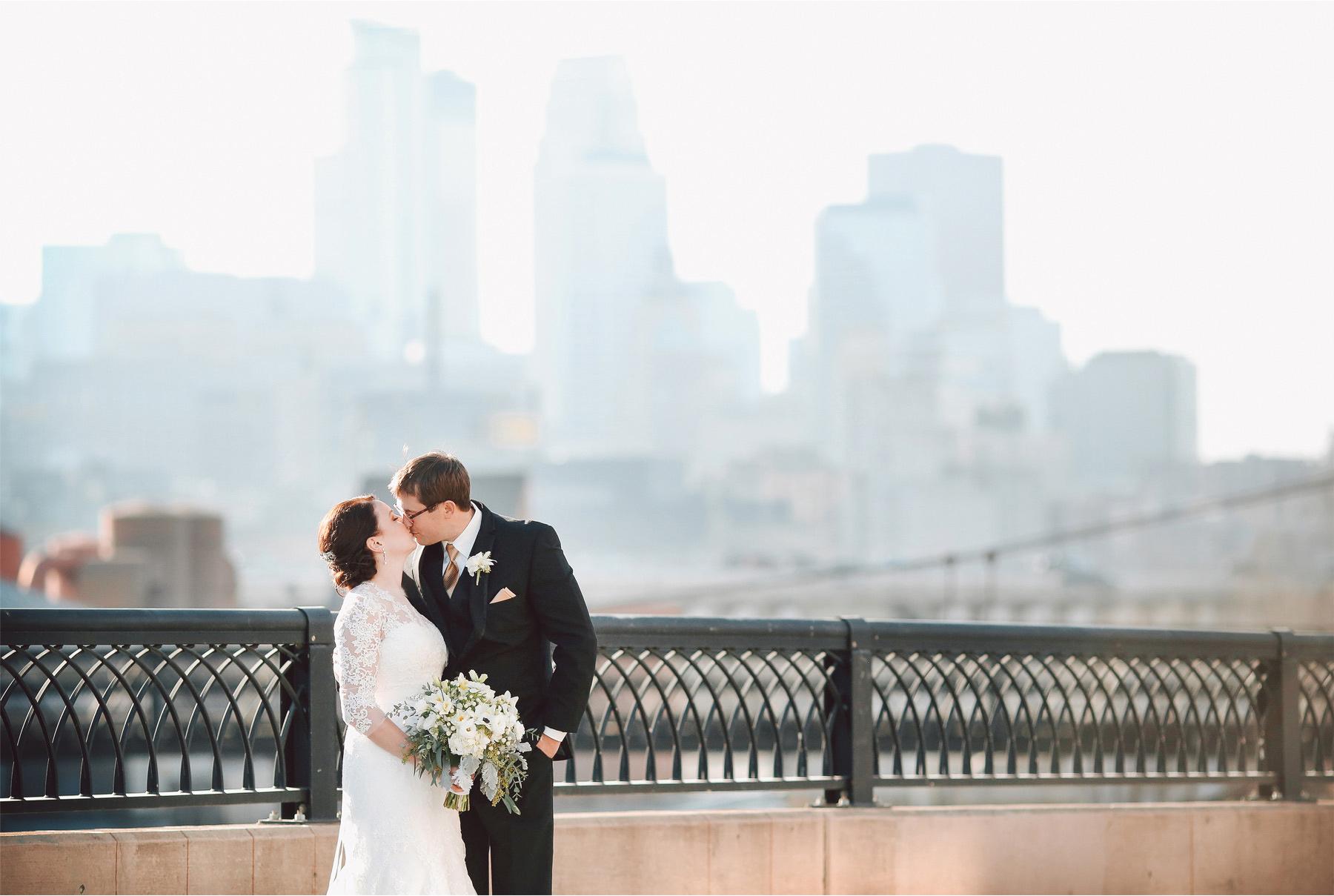 10-Minneapolis-Minnesota-Wedding-Photographer-by-Andrew-Vick-Photography-Winter-Bride-Groom-Downtown-Skyline-Kiss-Vintage-Sara-and-Rob.jpg