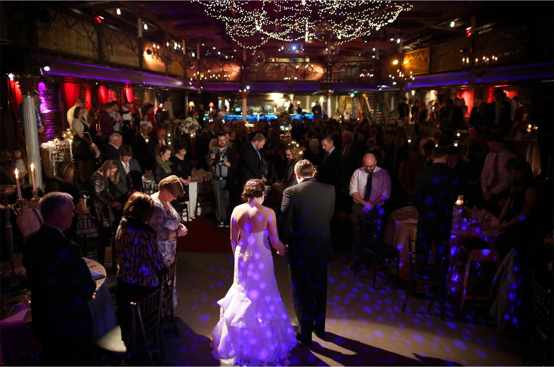 18-Minneapolis-Minnesota-Wedding-Photographer-by-Andrew-Vick-Photography-Winter-Varsity-Theater-Reception-Bride-Groom-Prayer-Guests-Sara-and-Rob.jpg