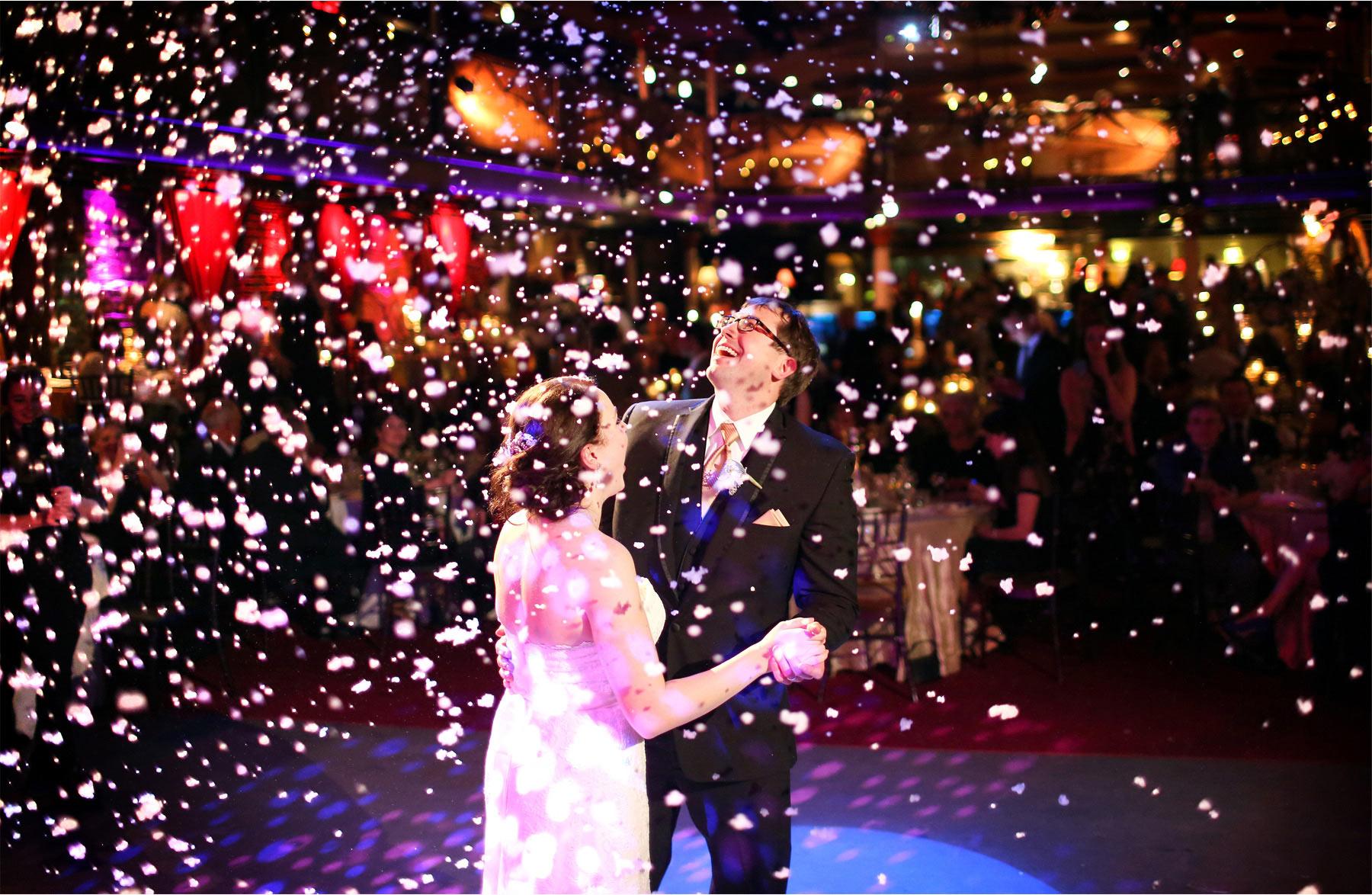 20-Minneapolis-Minnesota-Wedding-Photographer-by-Andrew-Vick-Photography-Winter-Varsity-Theater-Reception-Bride-Groom-Dance-Snow-Confetti-Sara-and-Rob.jpg