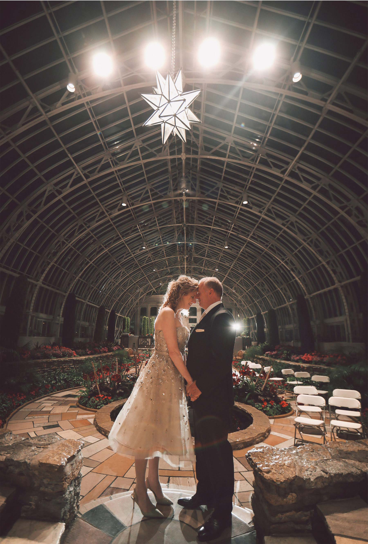 21-Saint-Paul-Minnesota-Wedding-Photographer-by-Andrew-Vick-Photography-Winter-Como-Park-Conservatory-Sunken-Garden-Bride-Groom-Flowers-Embrace-Night-Vintage-Dannette-and-Darren.jpg