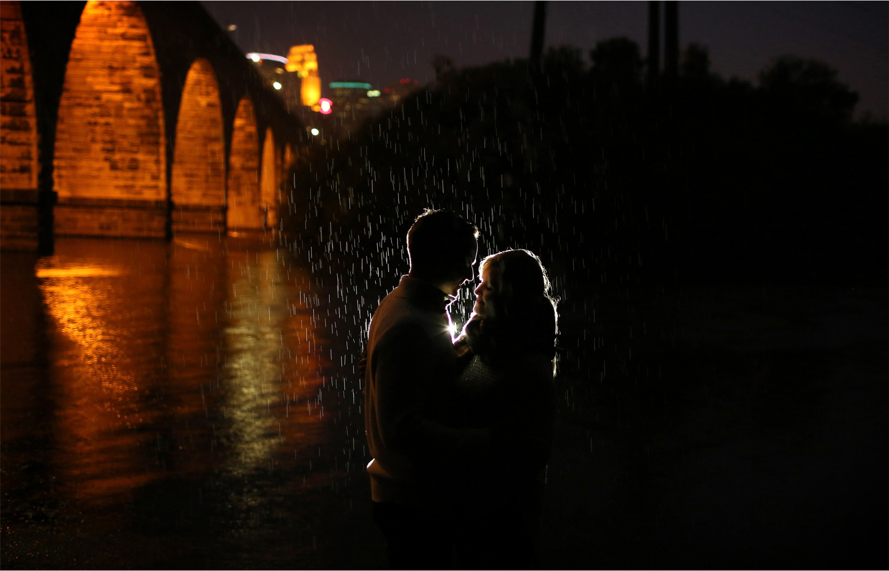 13-Minneapolis-Minnesota-Wedding-Photographer-by-Andrew-Vick-Photography-Fall-Autumn-Engagement-Bride-Groom-Downtown-Skyline-Stone-Arch-Bridge-Night-Embrace-Mississippi-River-Rain-Mallory-and-Kyle.jpg