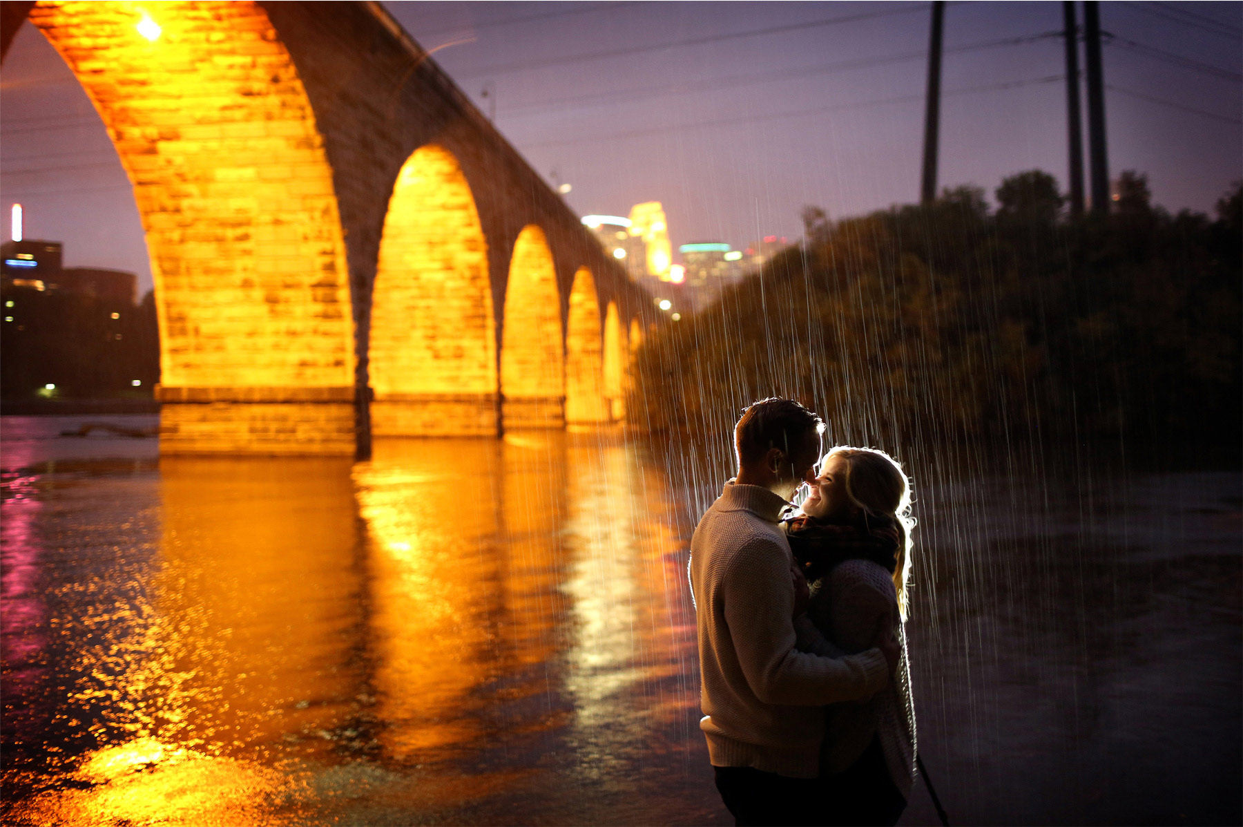 15-Minneapolis-Minnesota-Wedding-Photographer-by-Andrew-Vick-Photography-Fall-Autumn-Engagement-Bride-Groom-Downtown-Skyline-Stone-Arch-Bridge-Night-Kiss-Mississippi-River-Rain-Mallory-and-Kyle.jpg