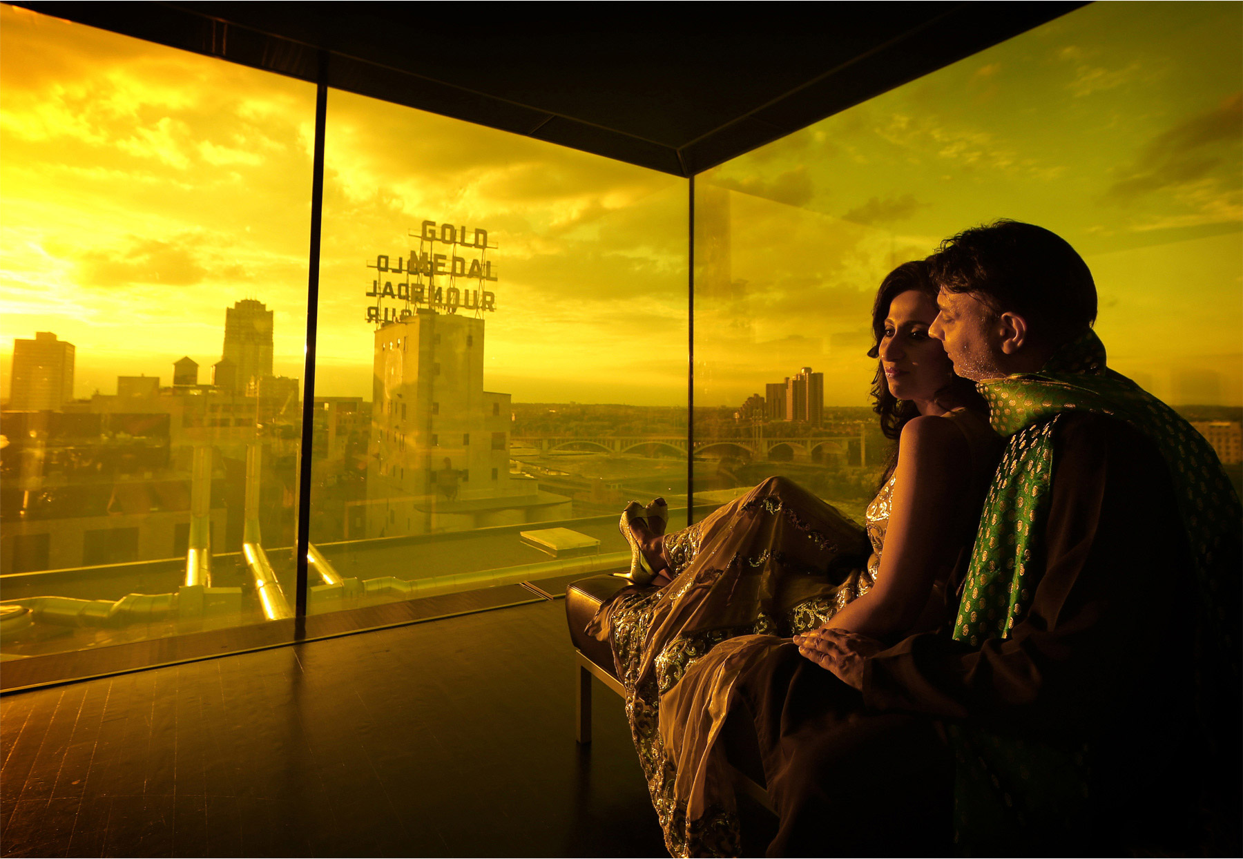 17-Minneapolis-Minnesota-Wedding-Photographer-by-Andrew-Vick-Photography-Summber-Engagement-Bride-Groom-Guthrie-Theater-Yellow-Room-Level-Nine-Embrace-Tradional-Indian-Clothing-Downtown-Gold-Metal-Sign-Natasha-and-Sohail.jpg