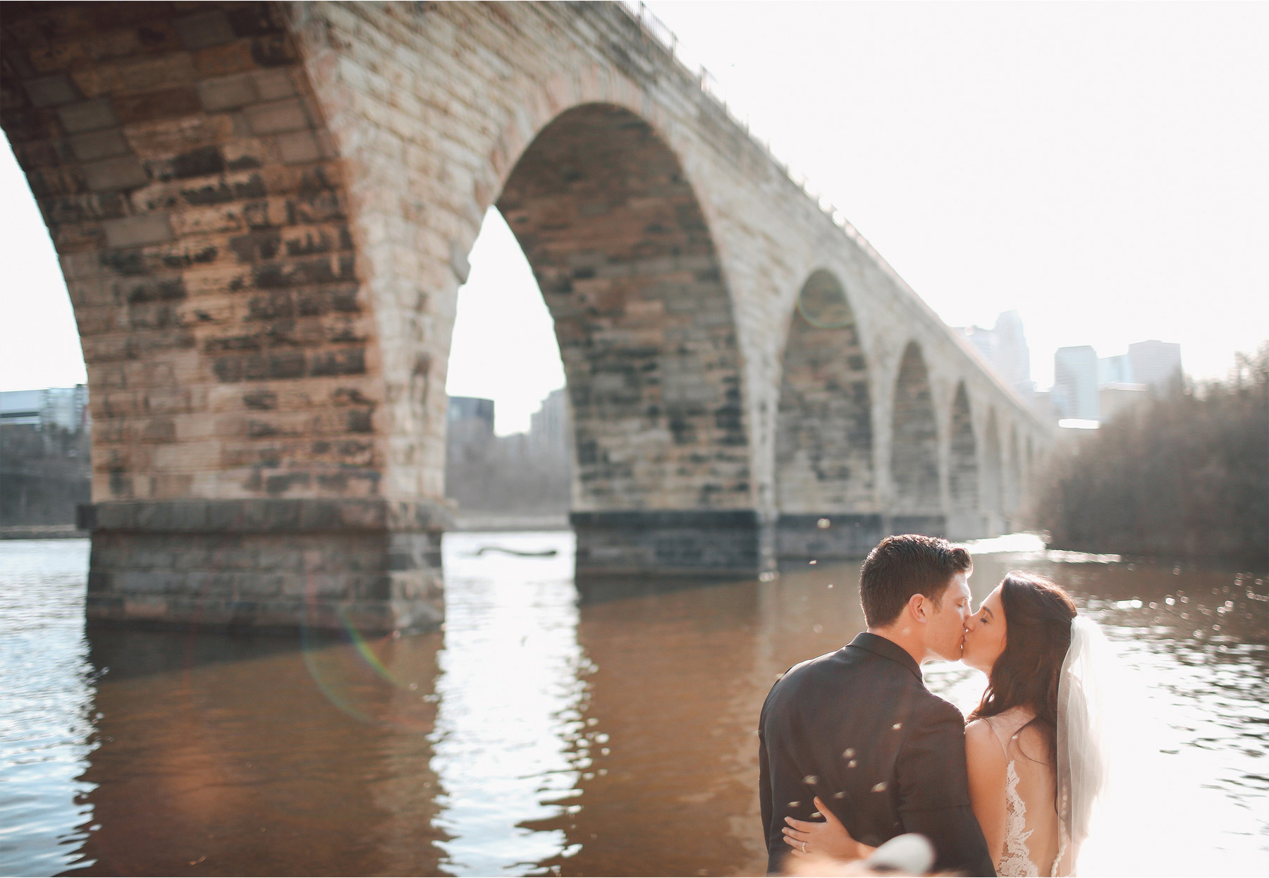 16-Minneapolis-Minnesota-Wedding-Photographer-by-Andrew-Vick-Photography-Stone-Arch-Bridge-Spring-Bride-Groom-Kiss-Mississippi-River-Vintage-Laughter-Alex-and-Andy.jpg