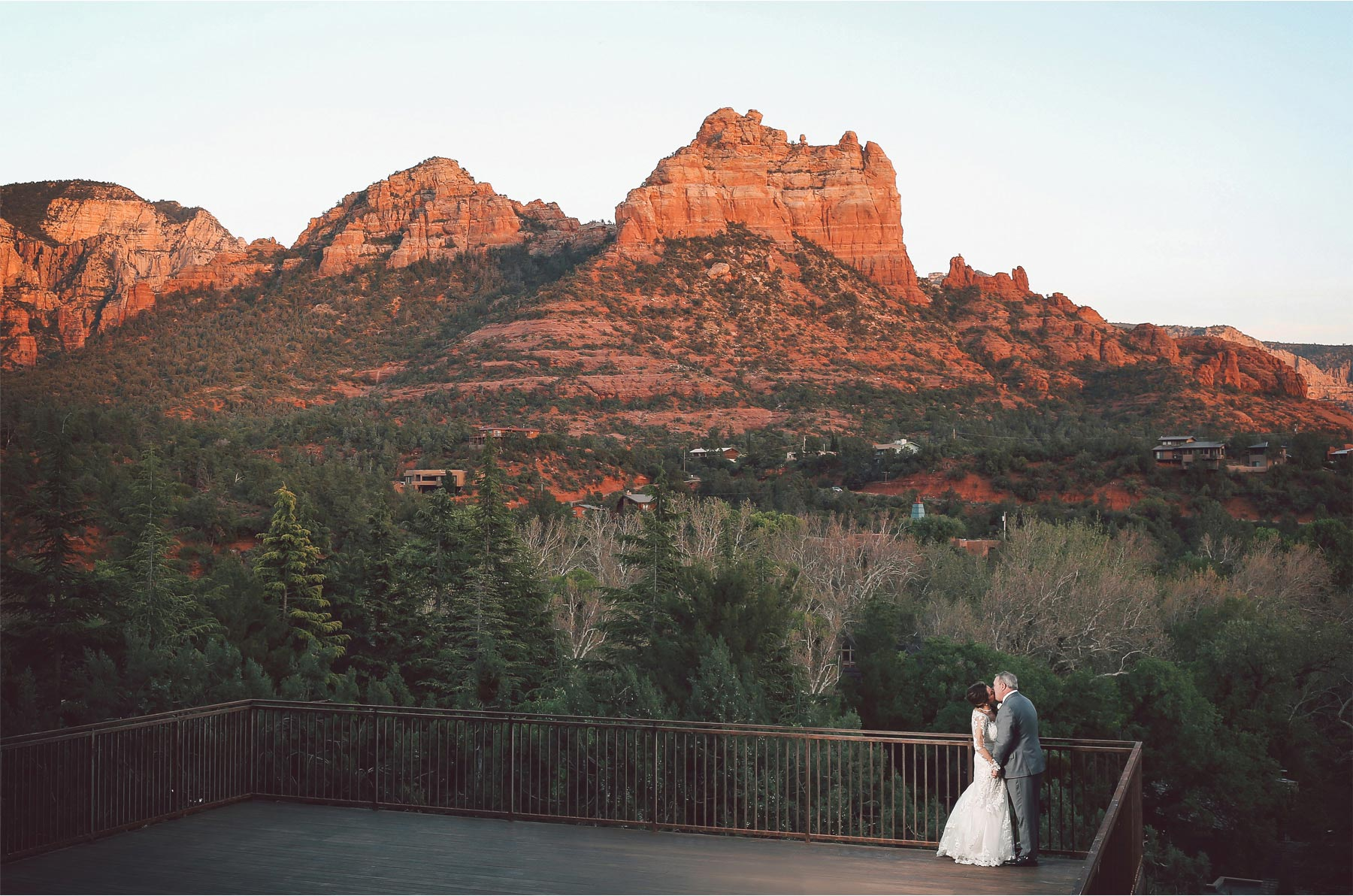 24-Sedona-Arizona-Wedding-Photographer-by-Andrew-Vick-Photography-Spring--LAuberge-de-Sedona-Resort-Reception-Garden-Lawn-Bride-Groom-Deck-Mountains-Kiss-Vintage-Barbara-and-Mike.jpg