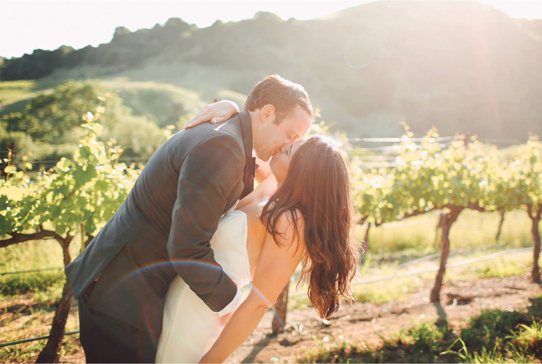 23-Napa-California-Wedding-Photographer-by-Andrew-Vick-Photography-Spring-Destination-Carneros-Resort-and-Spa-Bride-Groom-Vineyard-Winery-Kiss-Dip-Vintage-Alex-and-Roger.jpg