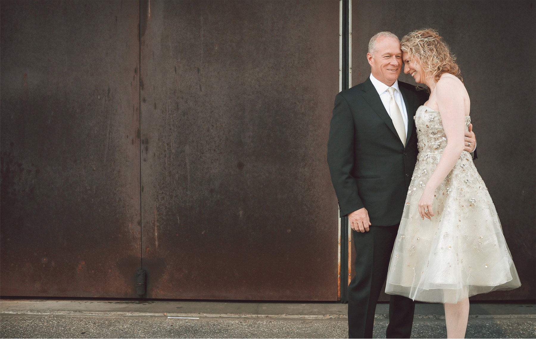 01-Minneapolis-Minnesota-Wedding-Photographer-by-Andrew-Vick-Photography-Spring-Downtown-Bride-Groom-Embrace-Vintage-Dannette-and-Darren.jpg