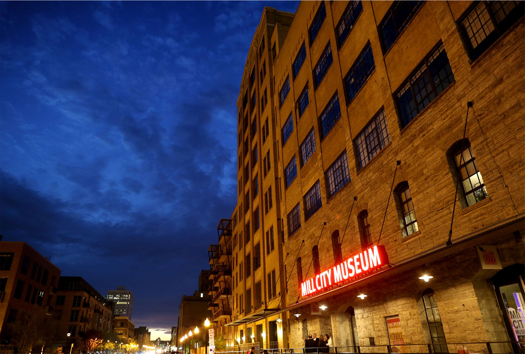 19-Minneapolis-Minnesota-Wedding-Photographer-by-Andrew-Vick-Photography-Spring-Mill-City-Museum-Downtown-Sign-Night-Dannette-and-Darren.jpg