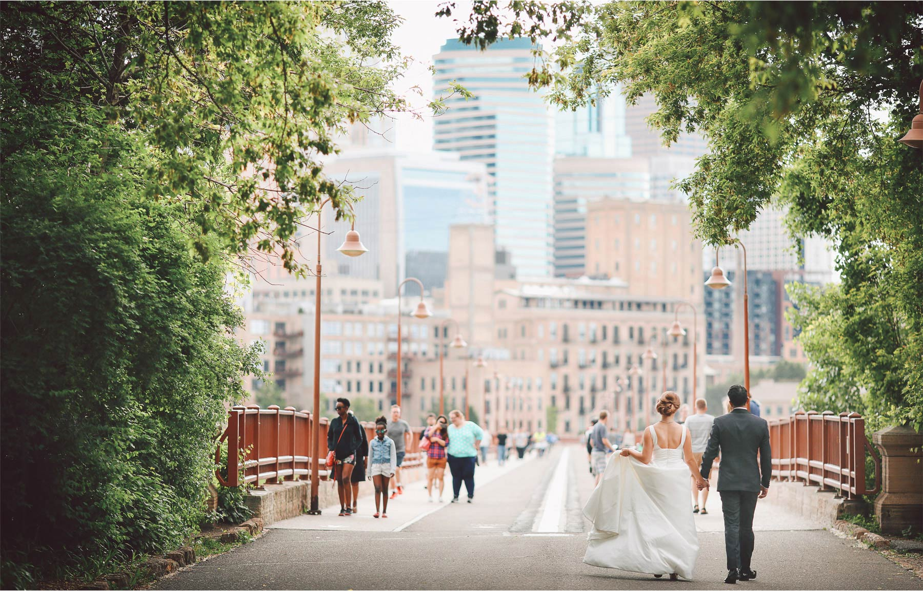 17-Minneapolis-Minnesota-Wedding-Photographer-by-Andrew-Vick-Photography--Spring-Stone-Arch-Bridge-Bride-Groom-Pedestrians-Downtown-Skyline-Vintage-Rachel-and-Venu.jpg
