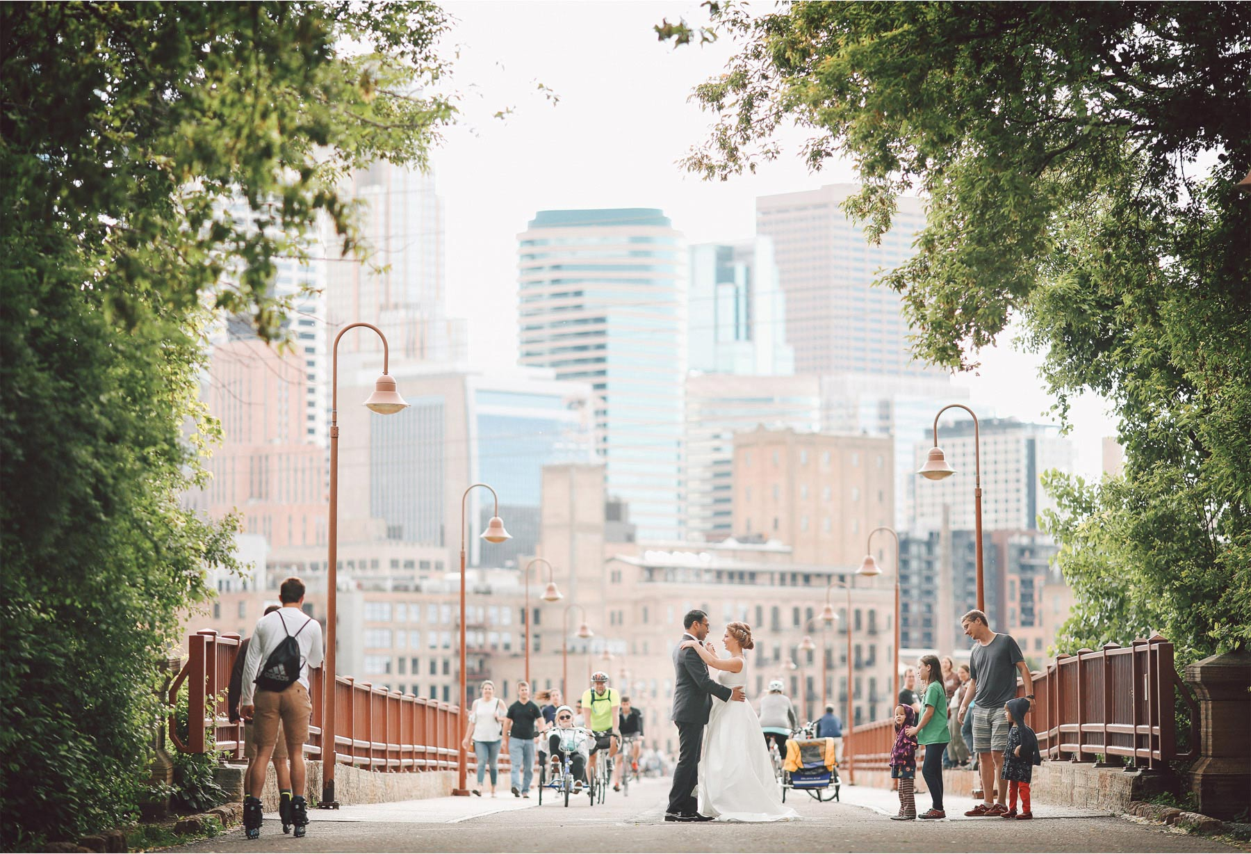 18-Minneapolis-Minnesota-Wedding-Photographer-by-Andrew-Vick-Photography--Spring-Stone-Arch-Bridge-Bride-Groom-Pedestrians-Downtown-Skyline-Dance-Vintage-Rachel-and-Venu.jpg