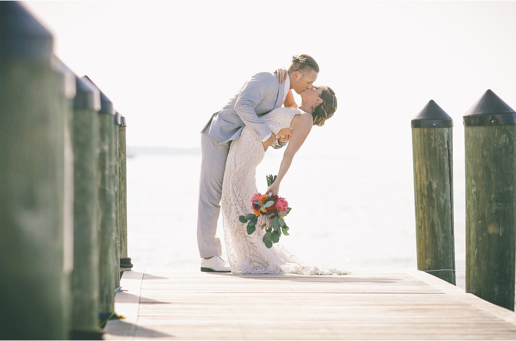 08-Key-Largo-Florida-Keys-Wedding-Photographer-by-Andrew-Vick-Photography-Playa-Largo-Resort-and-Spa-Hotel-Destination-Winter-First-Meeting-Look-Bride-Groom-Docks-Kiss-Dip-Flowers-Ocean-Water-Vintage-Carrie-and-Brian.jpg