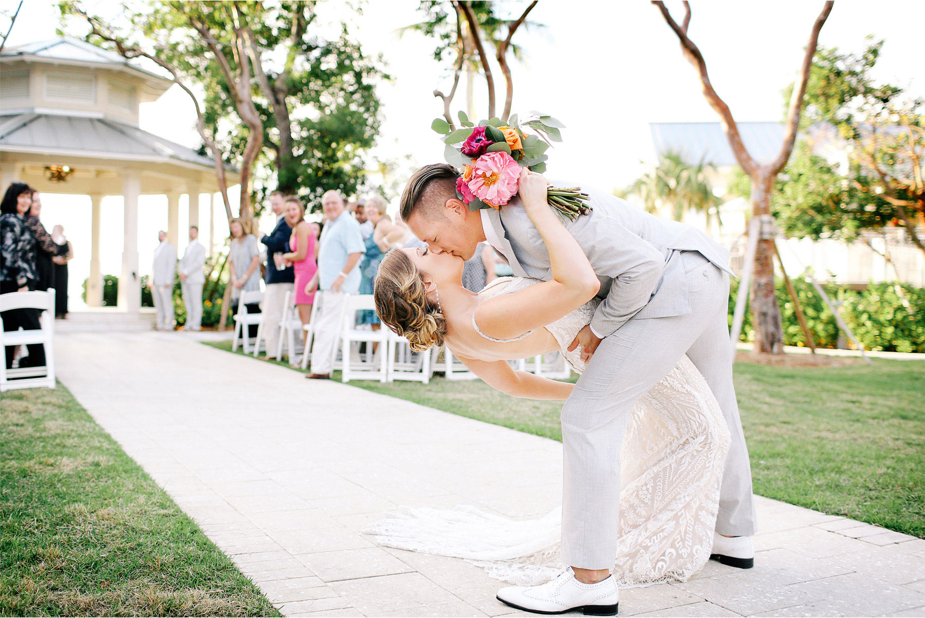 15-Key-Largo-Florida-Keys-Wedding-Photographer-by-Andrew-Vick-Photography-Playa-Largo-Resort-and-Spa-Hotel-Destination-Winter-Ceremony-Bride-Groom-Recessional-Dip-Kiss-Carrie-and-Brian.jpg