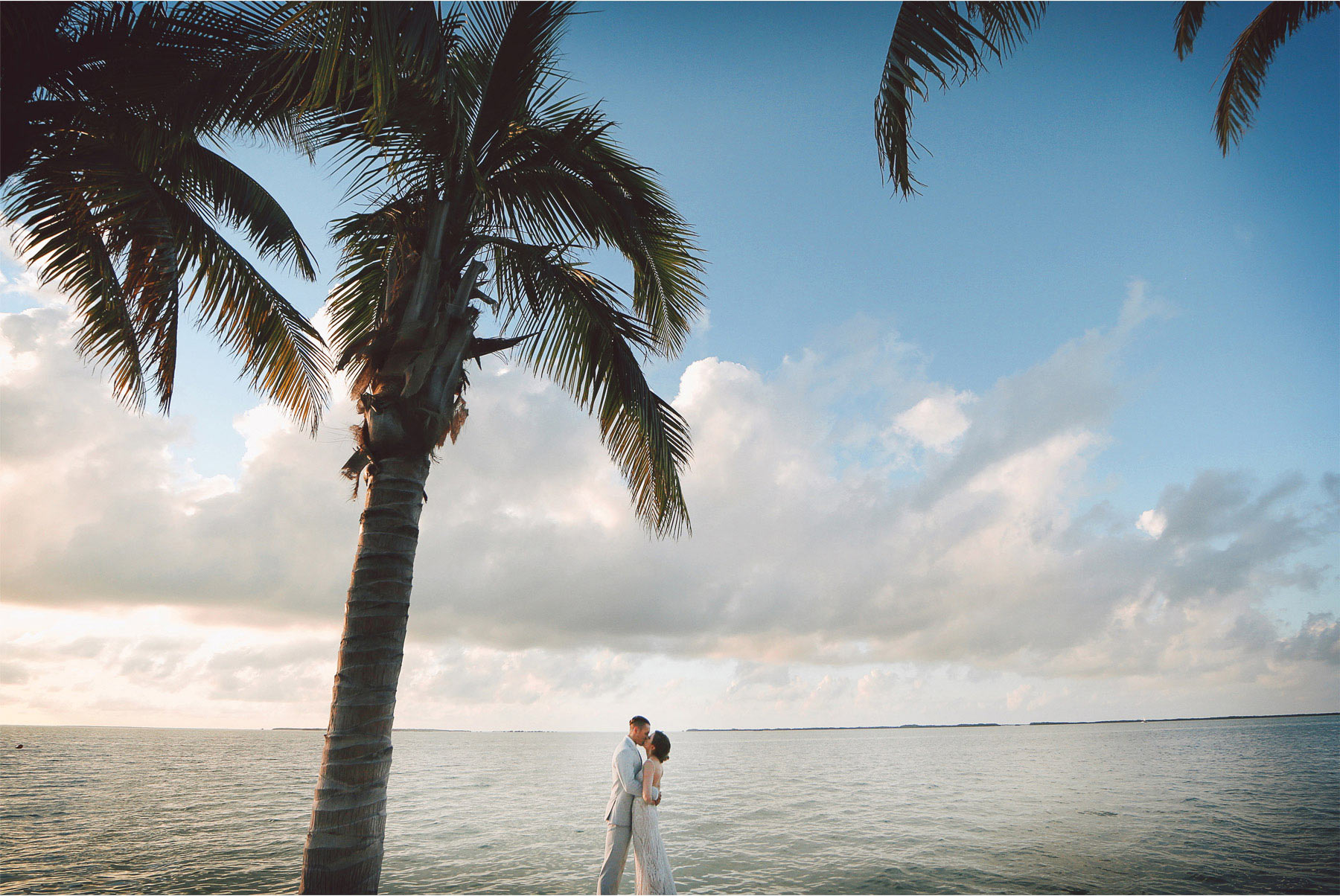 17-Key-Largo-Florida-Keys-Wedding-Photographer-by-Andrew-Vick-Photography-Playa-Largo-Resort-and-Spa-Hotel-Destination-Winter-Bride-Groom-Kiss-Water-Ocean-Palm-Trees-Vintage-Carrie-and-Brian.jpg