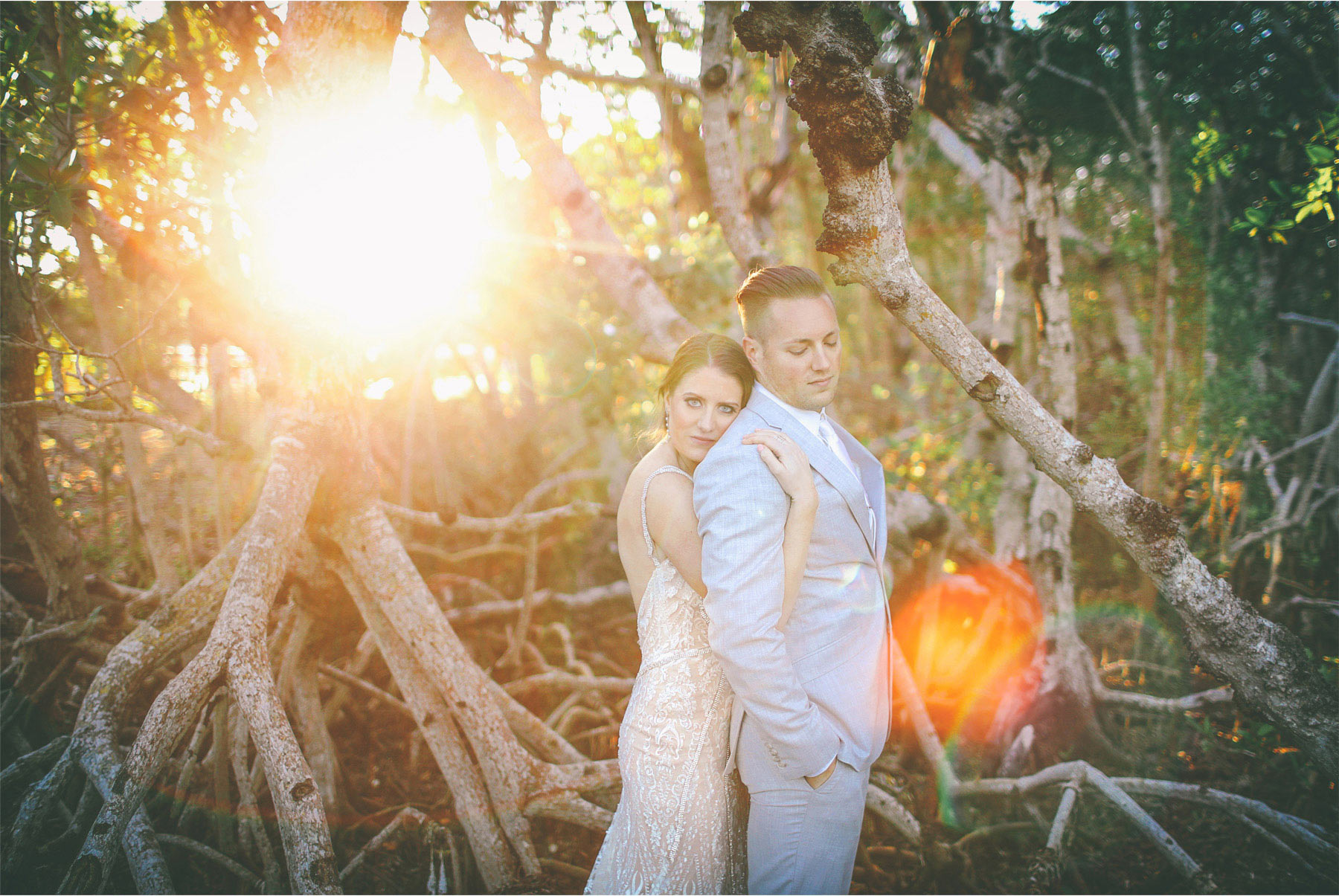 27-Key-Largo-Florida-Keys-Wedding-Photographer-by-Andrew-Vick-Photography-Playa-Largo-Resort-and-Spa-Hotel-Destination-Winter-Wear-It-Again-Bride-Groom-Trees-Sunflares-Embrace-Carrie-and-Brian.jpg