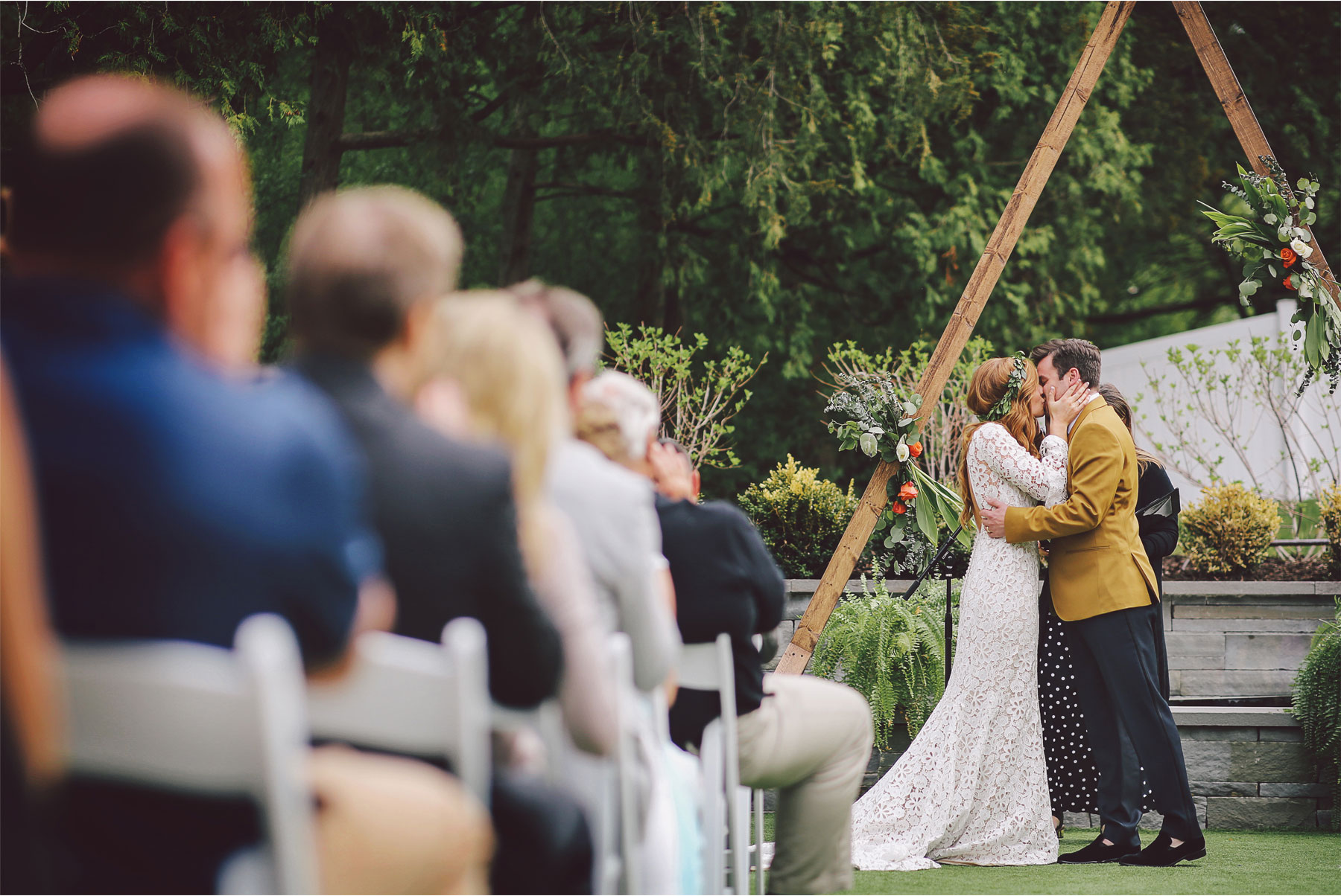 15-Minneapolis-Minnesota-Wedding-Photography-by-Andrew-Vick-Photography-Hutton-House-Outdoor-Ceremony-Vows-Mustard-Suit-Bohemian-First-Kiss-Kelsey-and-Matt.jpg