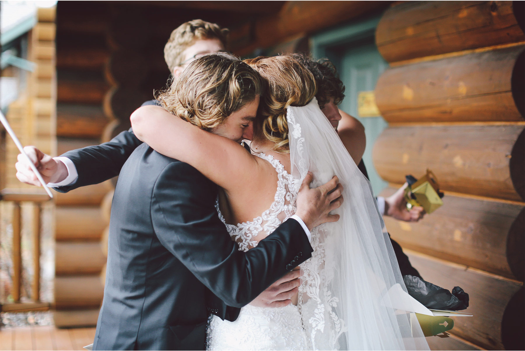 04-Minnesota-Wedding-by-Andrew-Vick-Photography-Grand-Superior-Lodge-Duluth-Two-Harbors-Bride-Brothers-Hug-Veronica-and-Tyler.jpg
